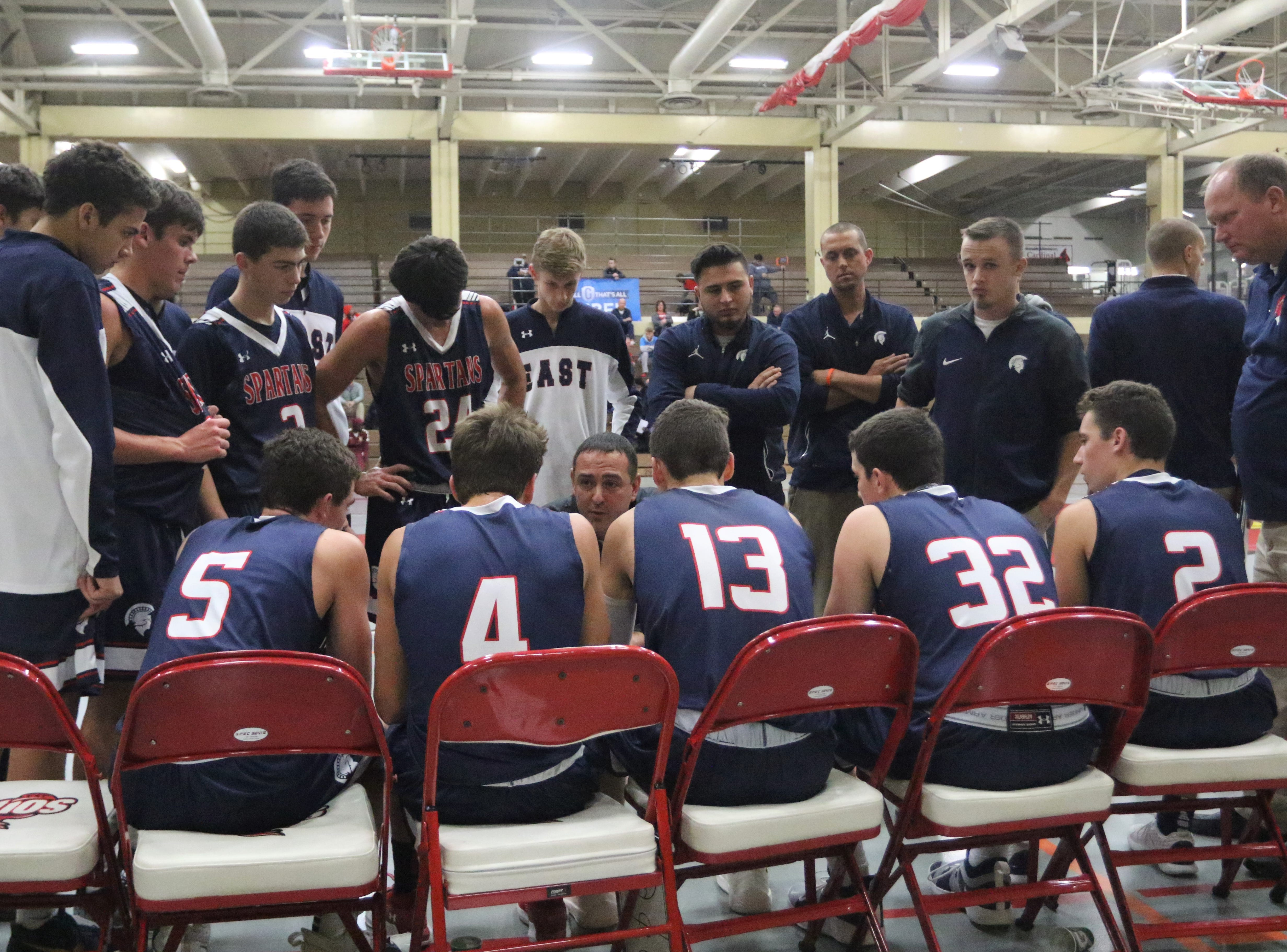 Brookfield East head coach Joe Rux instructs his players during a timeout while playing against Milwaukee Riverside during the Terry Porter Classic on Saturday.