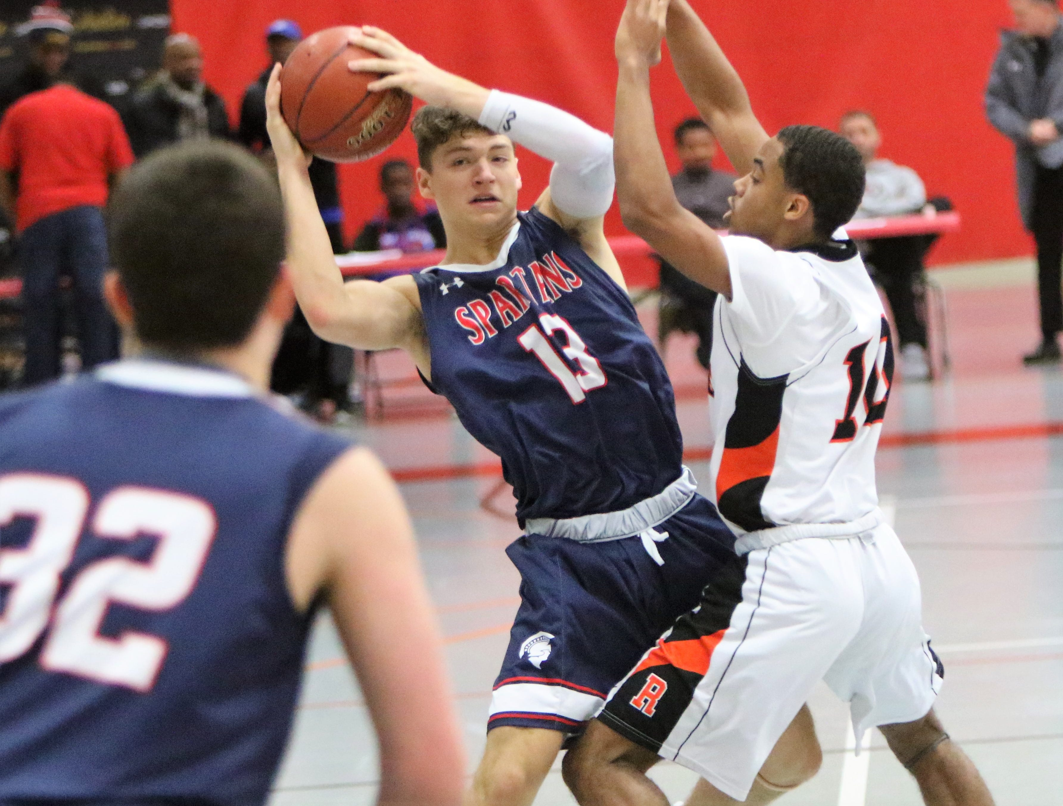 Brookfield East guard Thomas Francken looks for room to pass against Milwaukee Riverside during the Terry Porter Classic on Saturday.