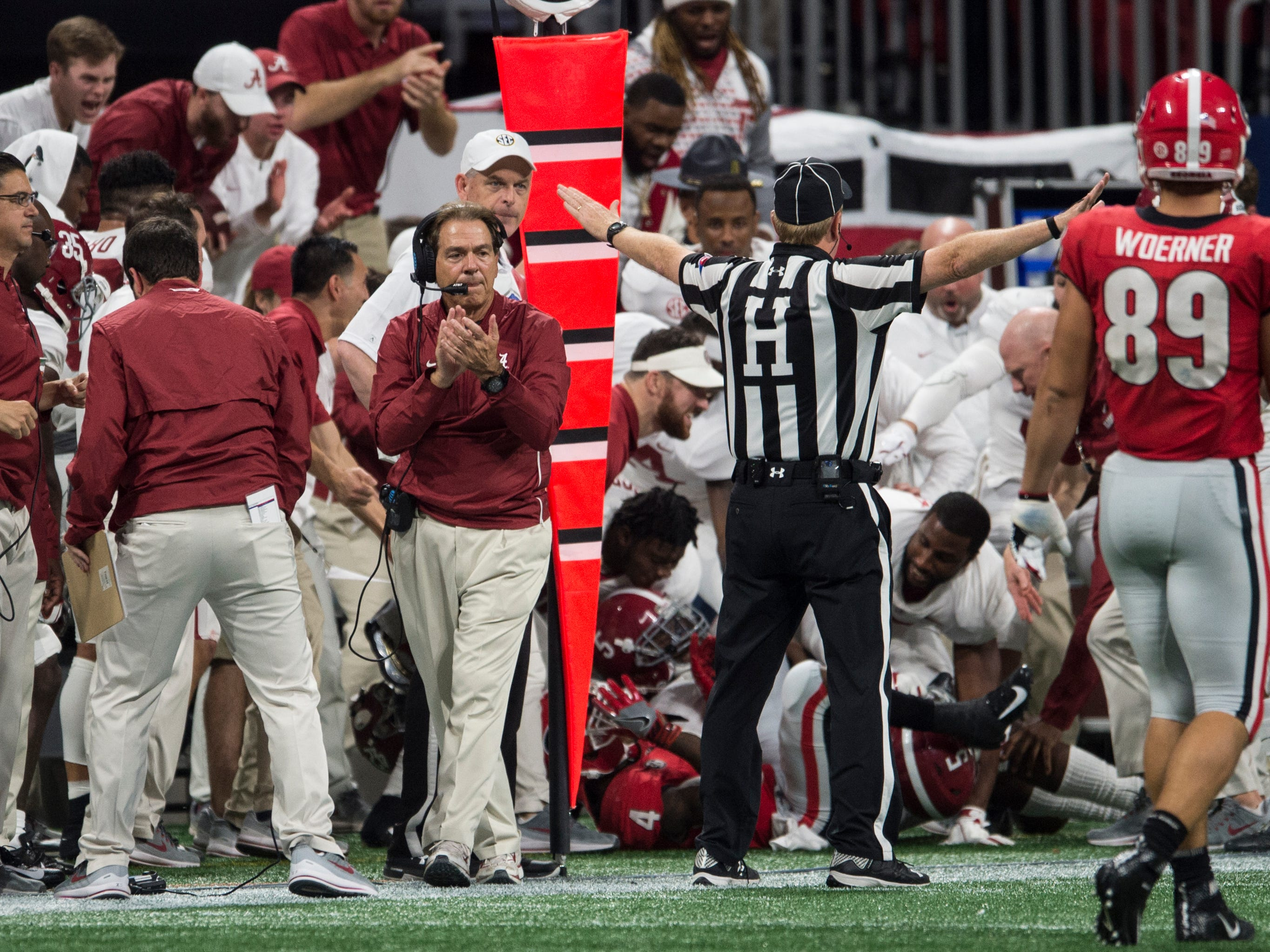 Alabama head coach Nick Saban cheers on his team form the sideline during the SEC Championship game at Mercedes-Benz Stadium in Atlanta, Ga., on Saturday Dec. 1, 2018. Alabama defeated Georgia 35-28.