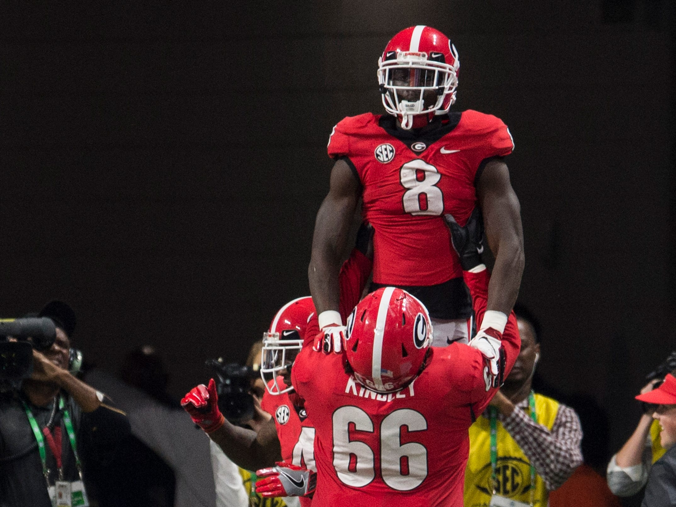 Georgia wide receiver Riley Ridley (8) and Georgia offensive lineman Solomon Kindley (66) celebrate Ridley's touchdown catch during the SEC Championship game at Mercedes-Benz Stadium in Atlanta, Ga., on Saturday Dec. 1, 2018. Alabama defeated Georgia 35-28.