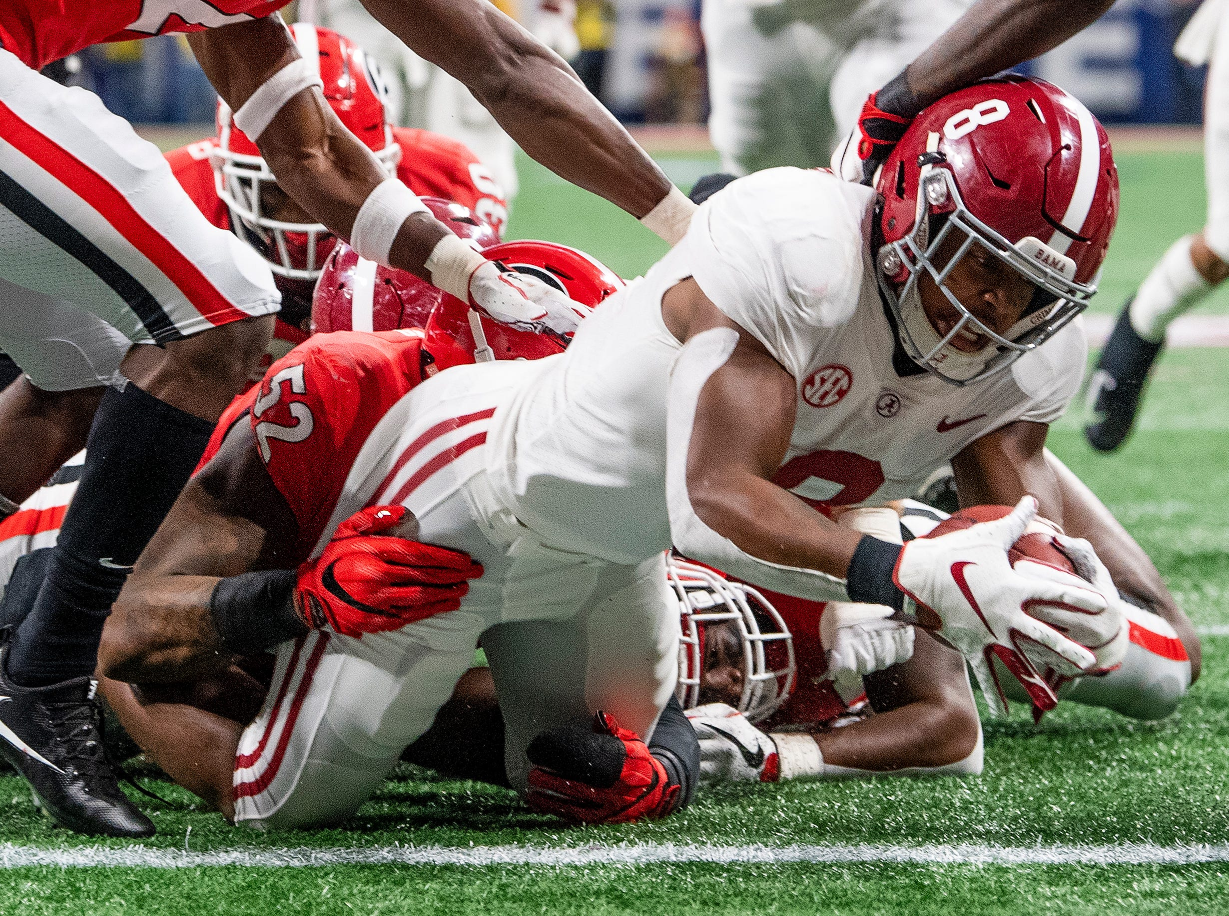 Alabama running back Josh Jacobs (8) is stopped short of the goal line by Georgia during first half action of the SEC Championship Game at Mercedes Benz Stadium in Atlanta, Ga., on Saturday December 1, 2018.