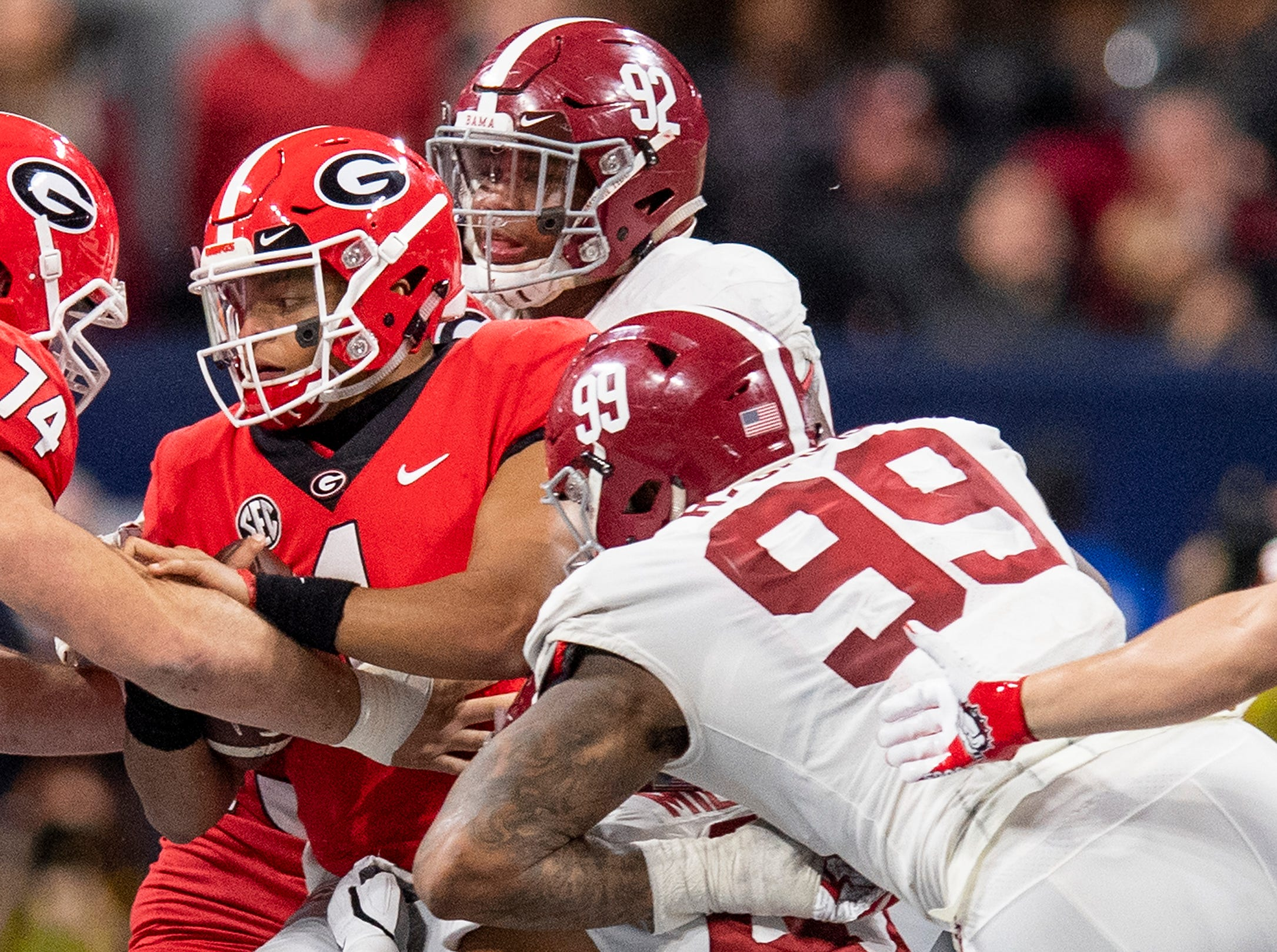 Georgia quarterback Justin Fields (1) is stopped on a fake punt by Alabama defenders in the SEC Championship Game at Mercedes Benz Stadium in Atlanta, Ga., on Saturday December 1, 2018.