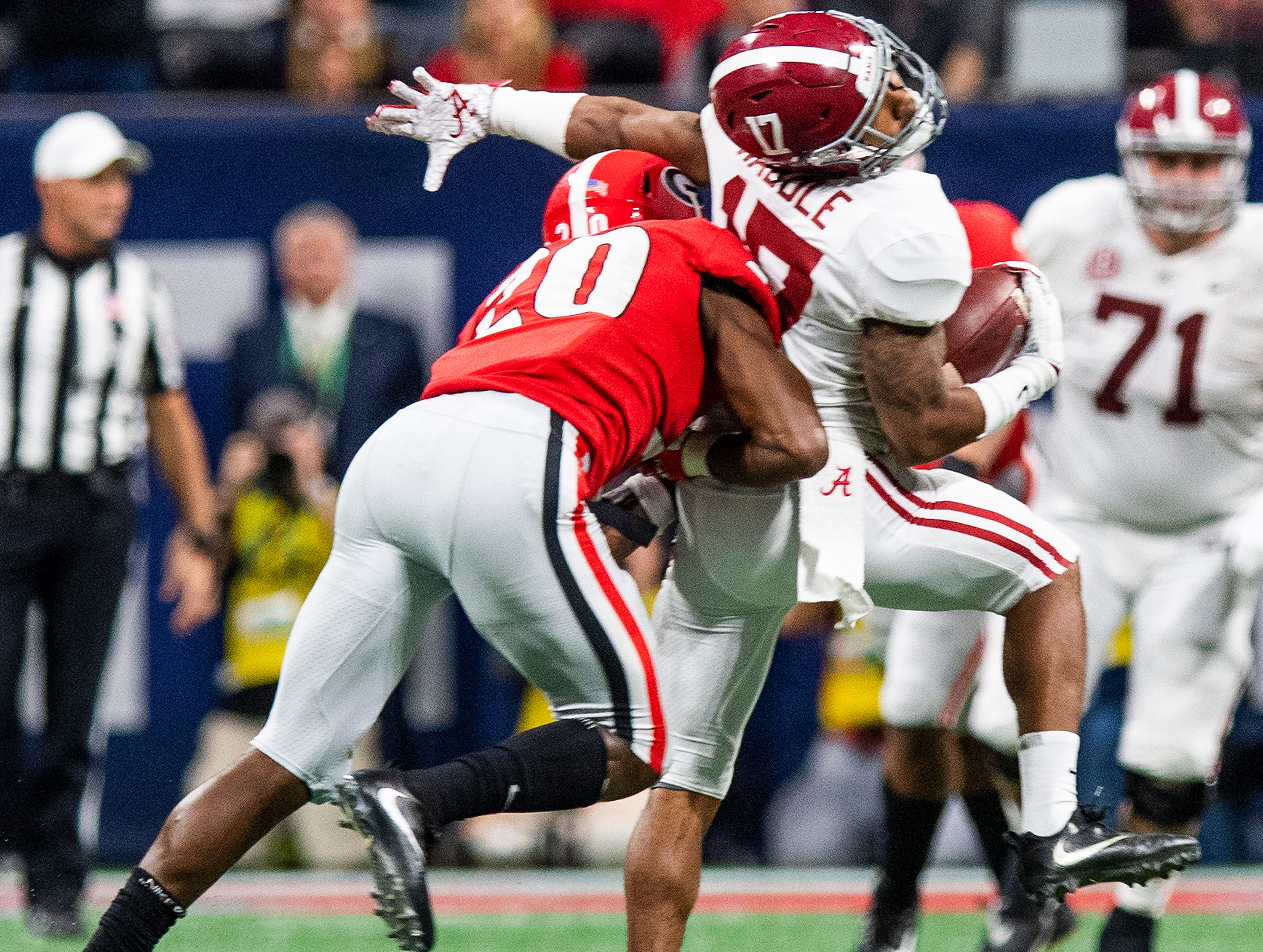 Georgia defensive back J.R. Reed (20) his Alabama wide receiver Jaylen Waddle (17) during the SEC Championship Game at Mercedes Benz Stadium in Atlanta, Ga., on Saturday December 1, 2018.