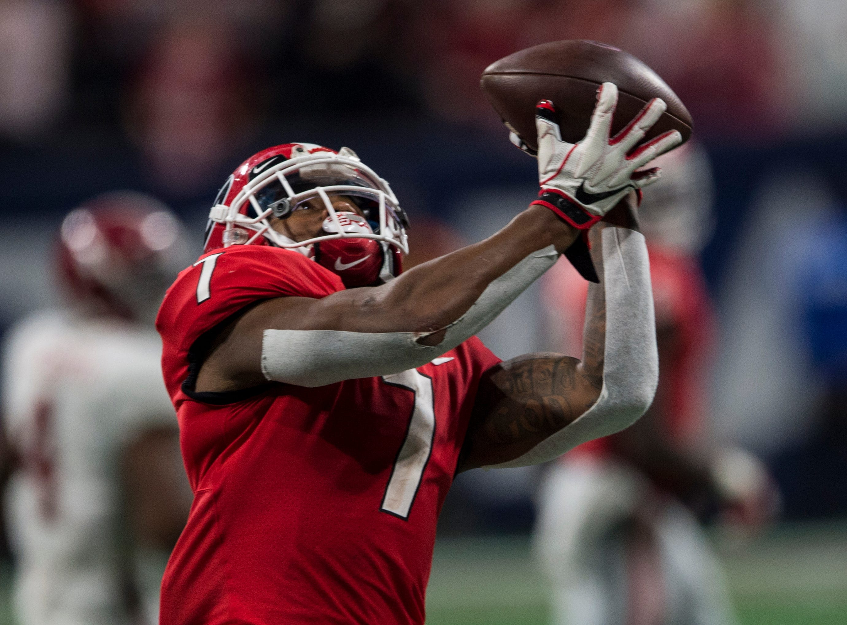 Georgia running back D'Andre Swift (7) catches a pass against Alabama during the SEC Championship game at Mercedes-Benz Stadium in Atlanta, Ga., on Saturday Dec. 1, 2018. Alabama defeated Georgia 35-28.