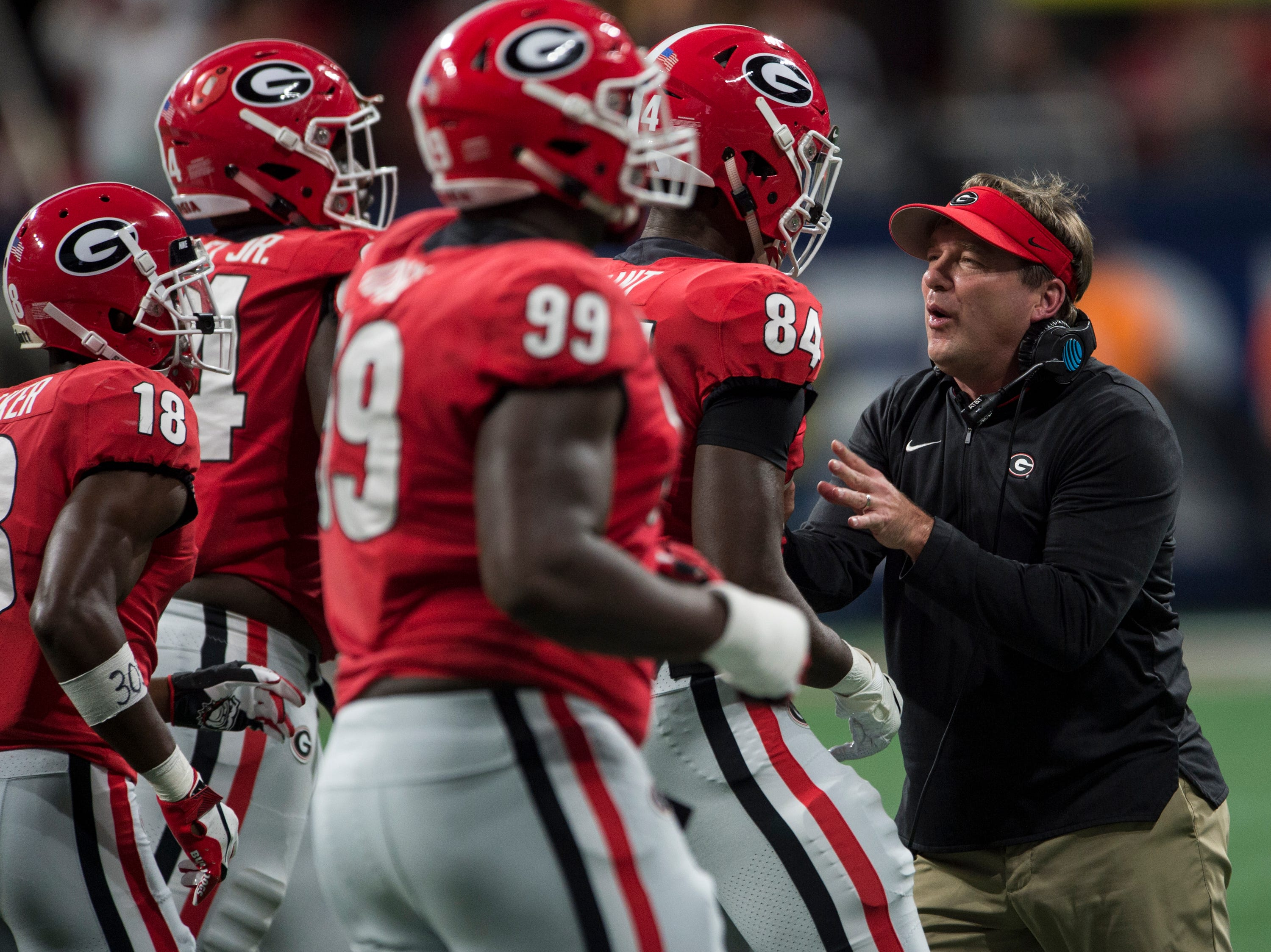 Georgia head coach Kirby Smart talks with his players as they come off the field during the SEC Championship game at Mercedes-Benz Stadium in Atlanta, Ga., on Saturday Dec. 1, 2018. Alabama defeated Georgia 35-28.