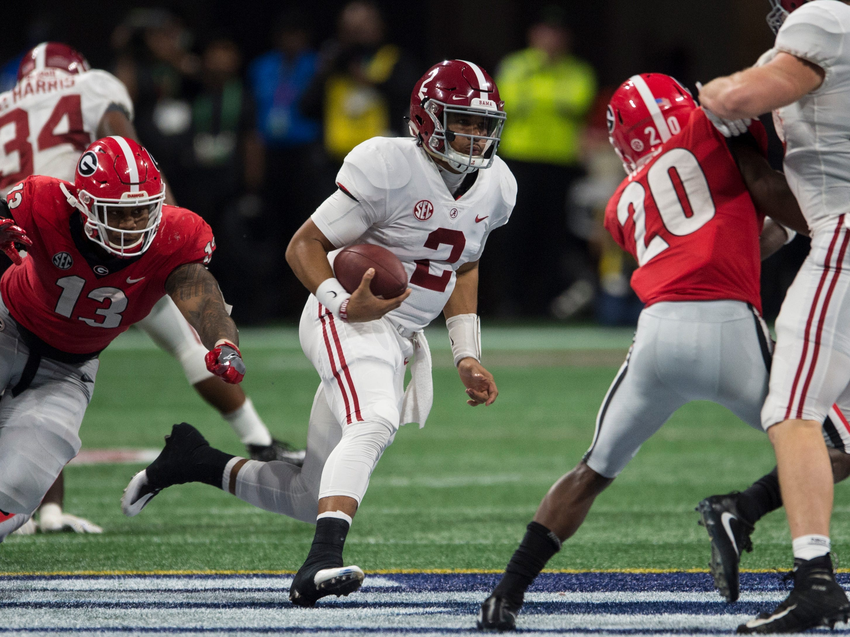Alabama quarterback Jalen Hurts (2) runs the ball down field during the SEC Championship game at Mercedes-Benz Stadium in Atlanta, Ga., on Saturday Dec. 1, 2018. Alabama defeated Georgia 35-28.