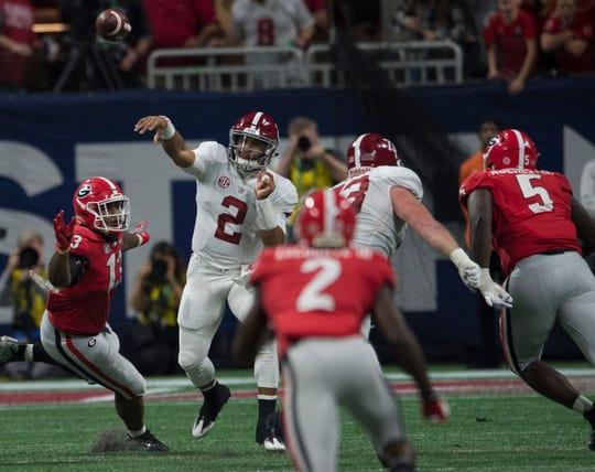 Alabama quarterback Jalen Hurts (2) throws the ball down field during the SEC Championship game at Mercedes-Benz Stadium in Atlanta, Ga., on Saturday Dec. 1, 2018. Alabama defeated Georgia 35-28.
