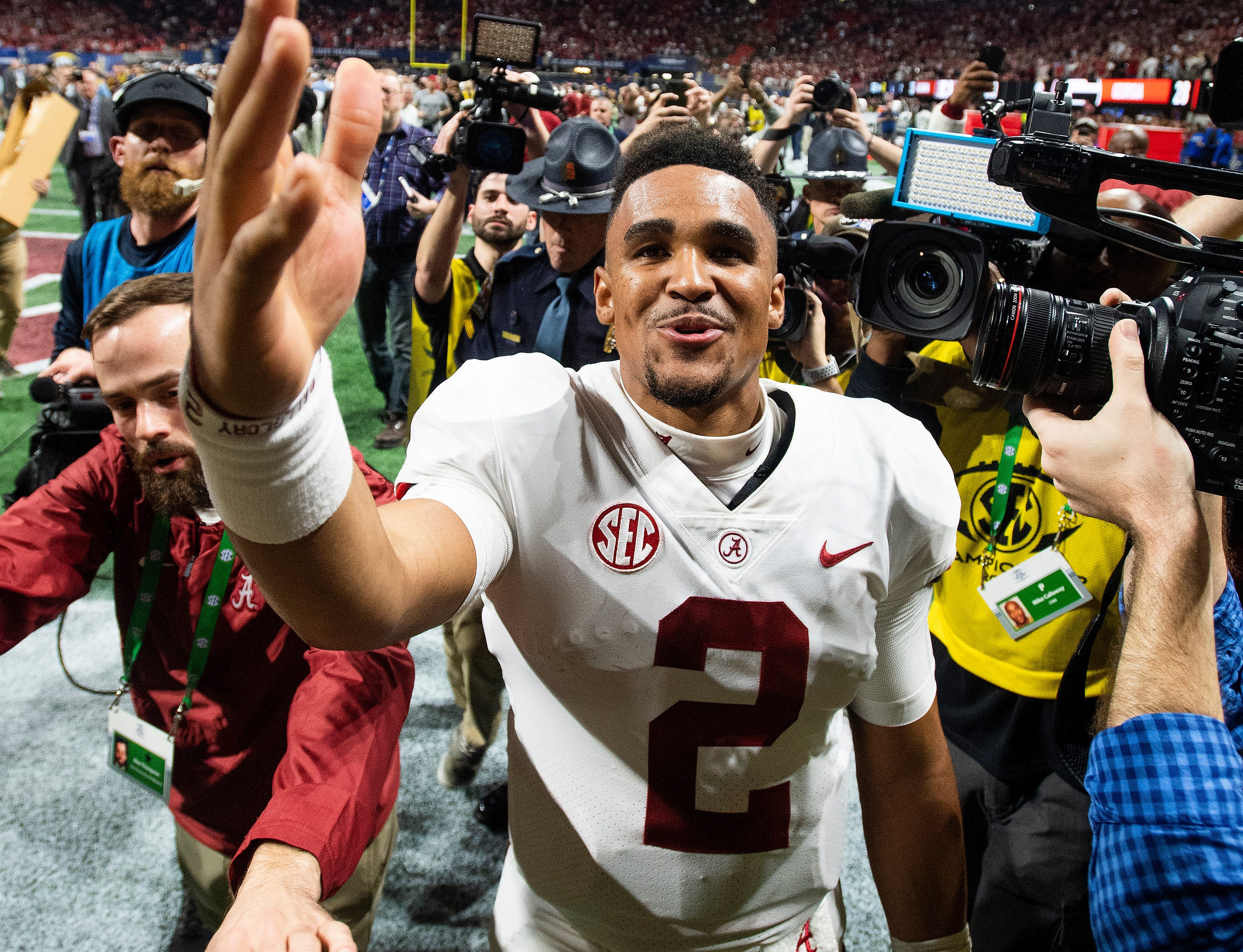 Alabama quarterback Jalen Hurts (2) throws a kiss to family after defeating Georgia in the SEC Championship Game at Mercedes Benz Stadium in Atlanta, Ga., on Saturday December 1, 2018.
