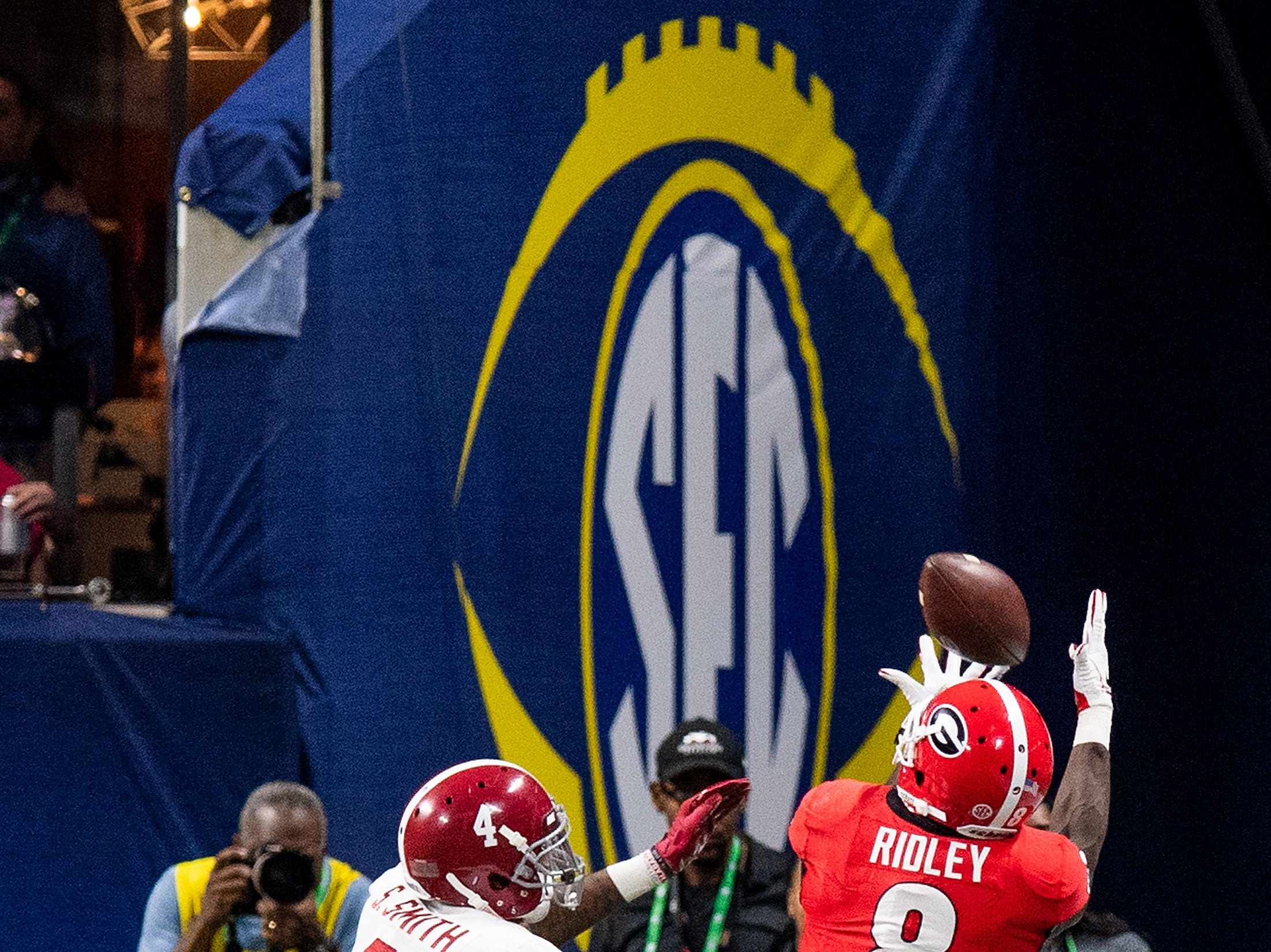 Georgia wide receiver Riley Ridley (8) catches a touchdown pass against Alabama defensive back Saivion Smith (4) in the SEC Championship Game at Mercedes Benz Stadium in Atlanta, Ga., on Saturday December 1, 2018.