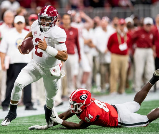 Alabama quarterback Jalen Hurts (2) carries the ball against Georgia in the SEC Championship Game at Mercedes Benz Stadium in Atlanta, Ga., on Saturday December 1, 2018.