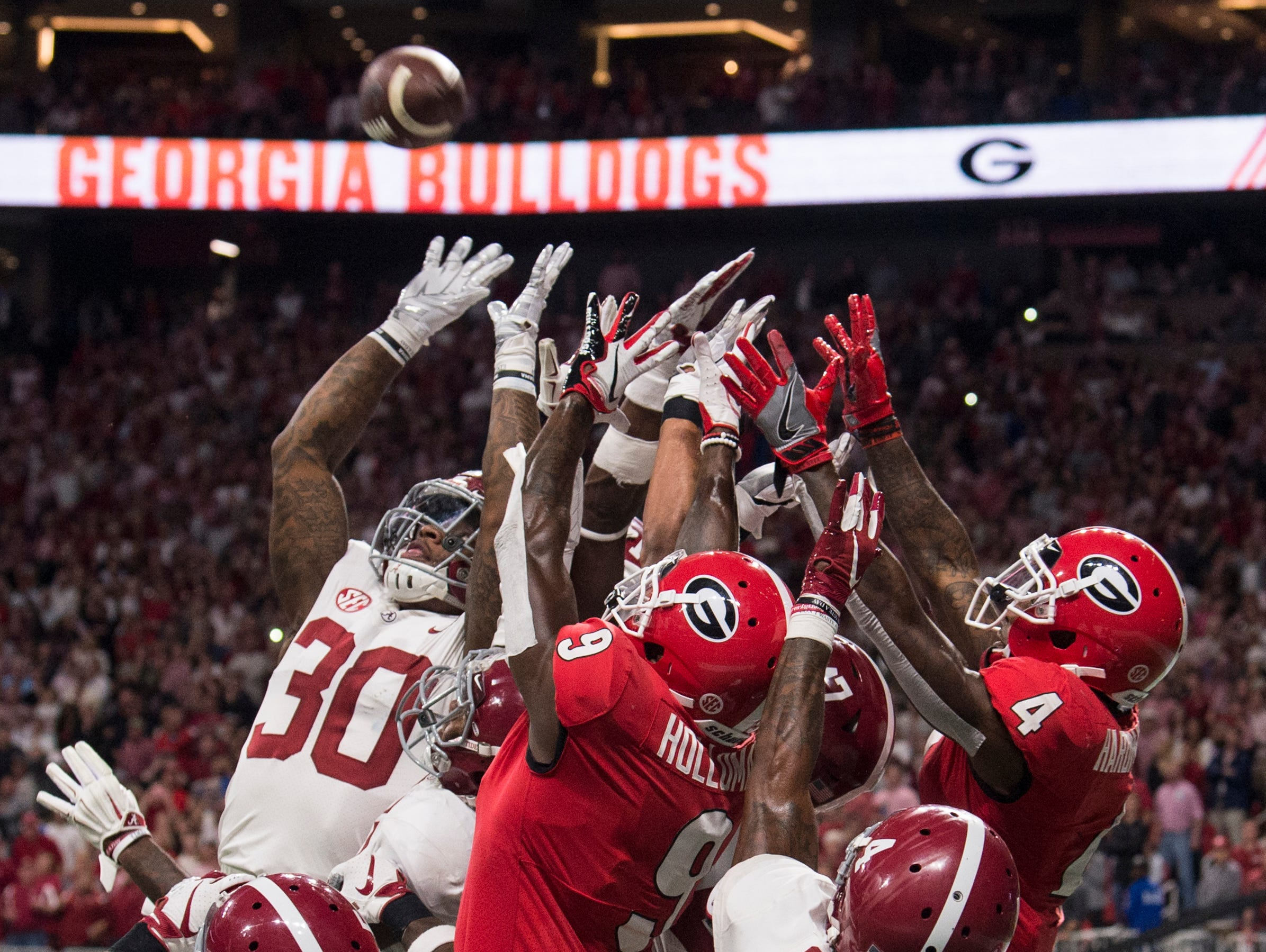 Alabama defenders and Georgia receivers jump for a hail mary pass during the SEC Championship game at Mercedes-Benz Stadium in Atlanta, Ga., on Saturday Dec. 1, 2018. Alabama defeated Georgia 35-28.