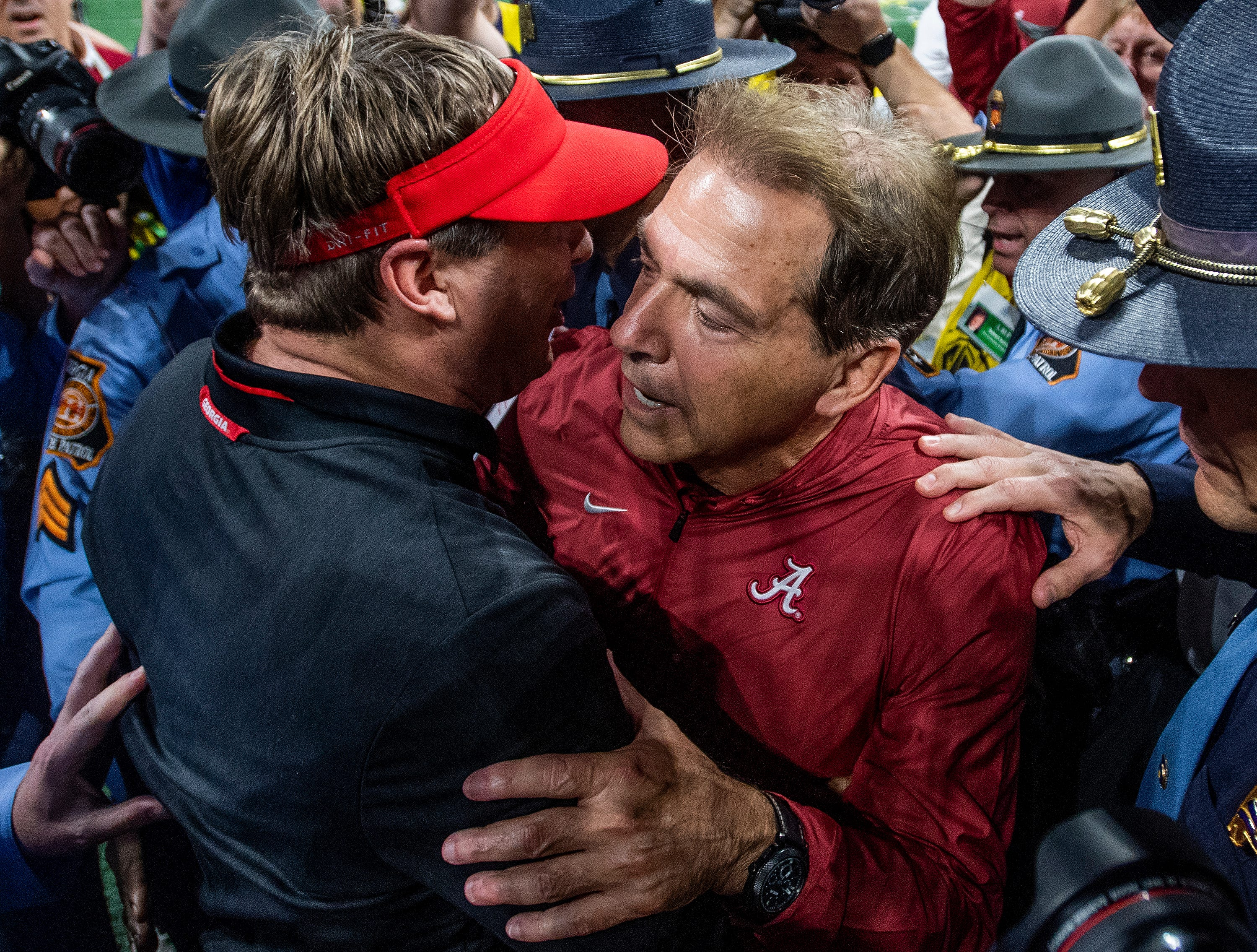 Alabama head coach Nick Saban greets Georgia head coach Kirby Smart after beating him in the SEC Championship Game at Mercedes Benz Stadium in Atlanta, Ga., on Saturday December 1, 2018.