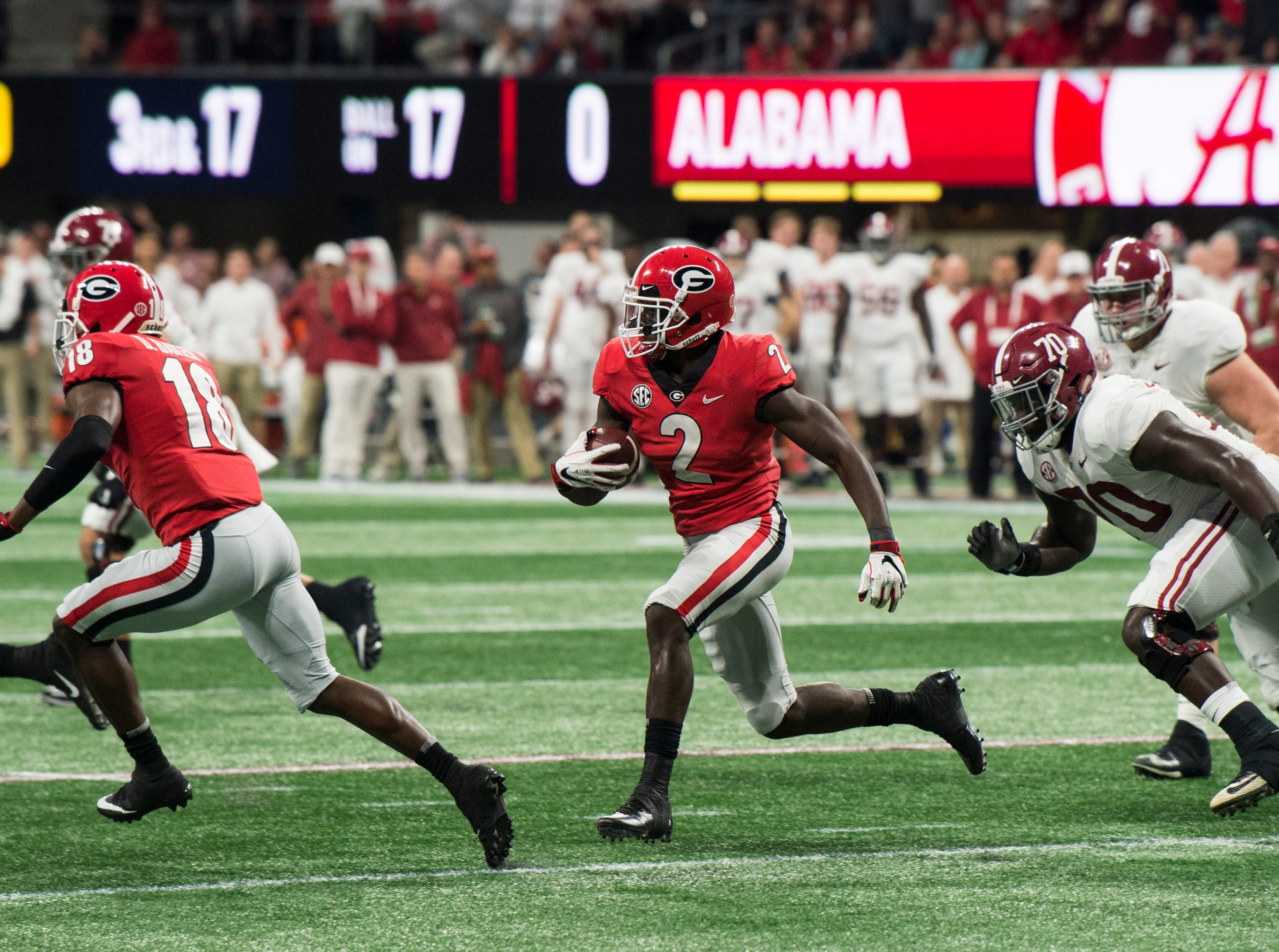 Georgia defensive back Richard LeCounte (2) returns the ball after catching an interception during the SEC Championship game at Mercedes-Benz Stadium in Atlanta, Ga., on Saturday Dec. 1, 2018. Alabama defeated Georgia 35-28.