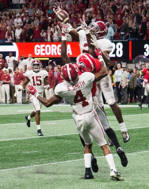 Alabama defensive back Jared Mayden (21) knocks down a hail mary pass intended for Georgia wide receiver Riley Ridley (8) during the SEC Championship game at Mercedes-Benz Stadium in Atlanta, Ga., on Saturday Dec. 1, 2018. Alabama defeated Georgia 35-28.