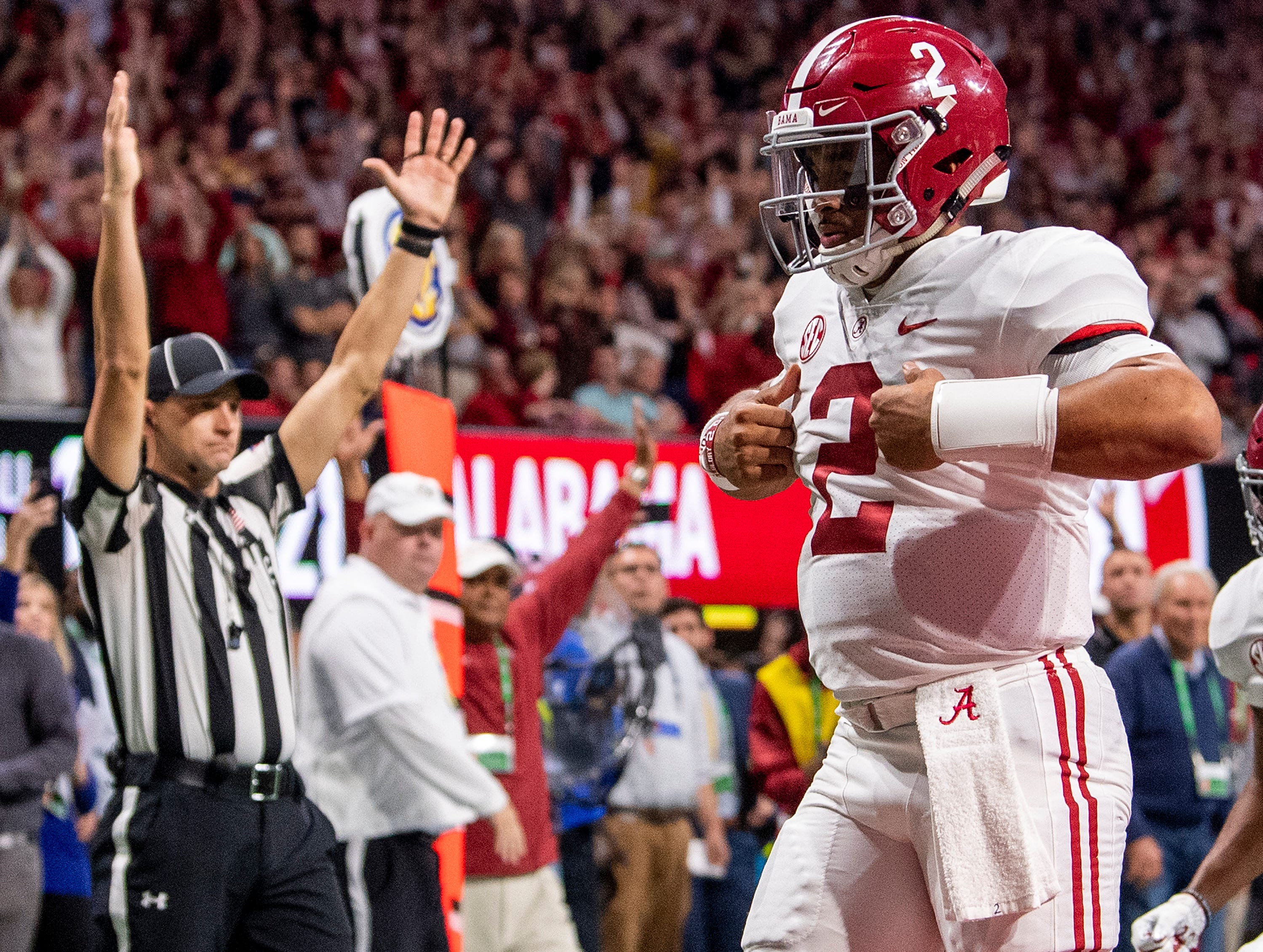 Alabama quarterback Jalen Hurts (2) does the superman after scoring the go ahead touchdown against Georgia in the SEC Championship Game at Mercedes Benz Stadium in Atlanta, Ga., on Saturday December 1, 2018.