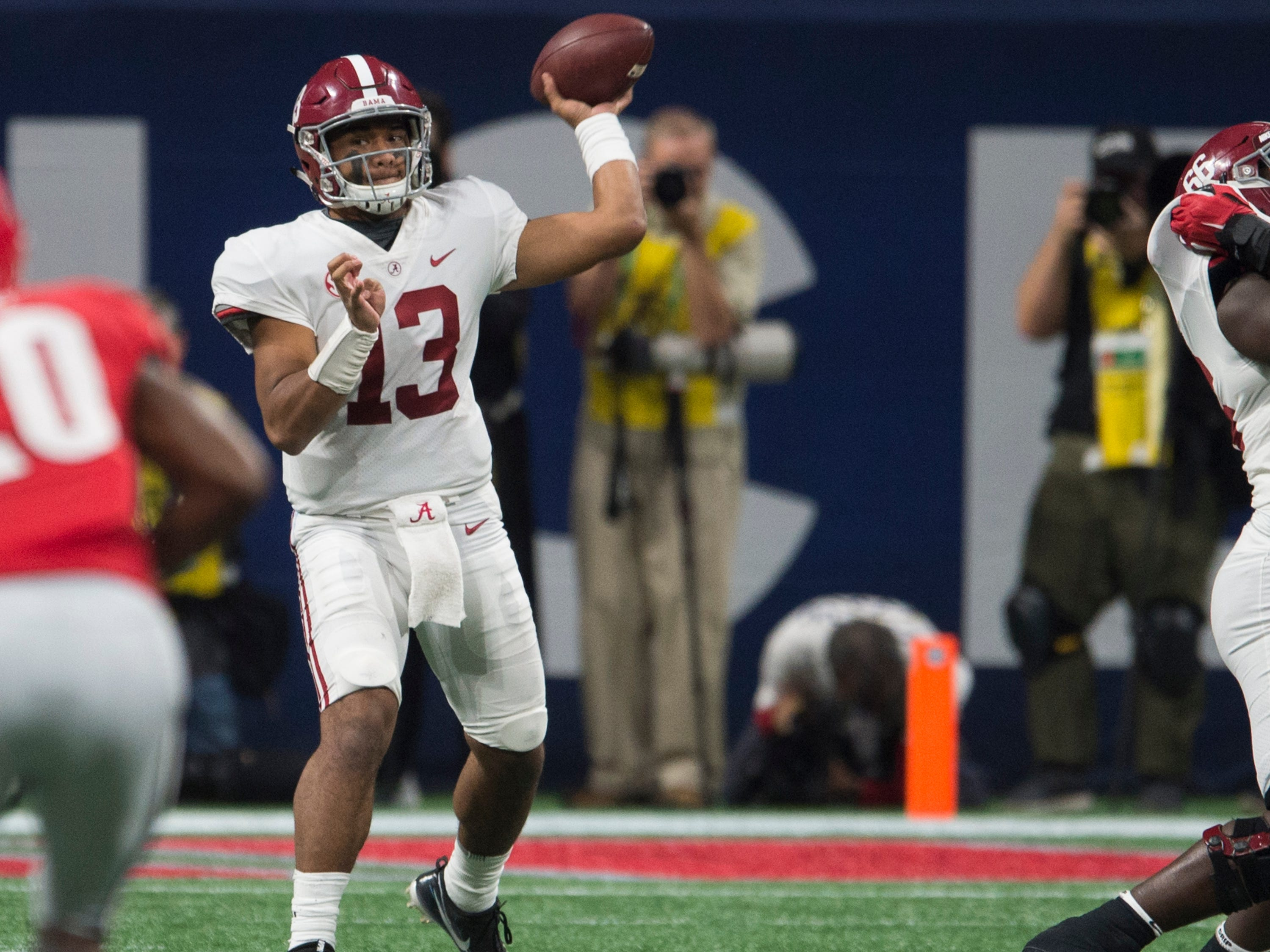 Alabama quarterback Tua Tagovailoa (13) throws the ball down field during the SEC Championship game at Mercedes-Benz Stadium in Atlanta, Ga., on Saturday Dec. 1, 2018. Alabama defeated Georgia 35-28.