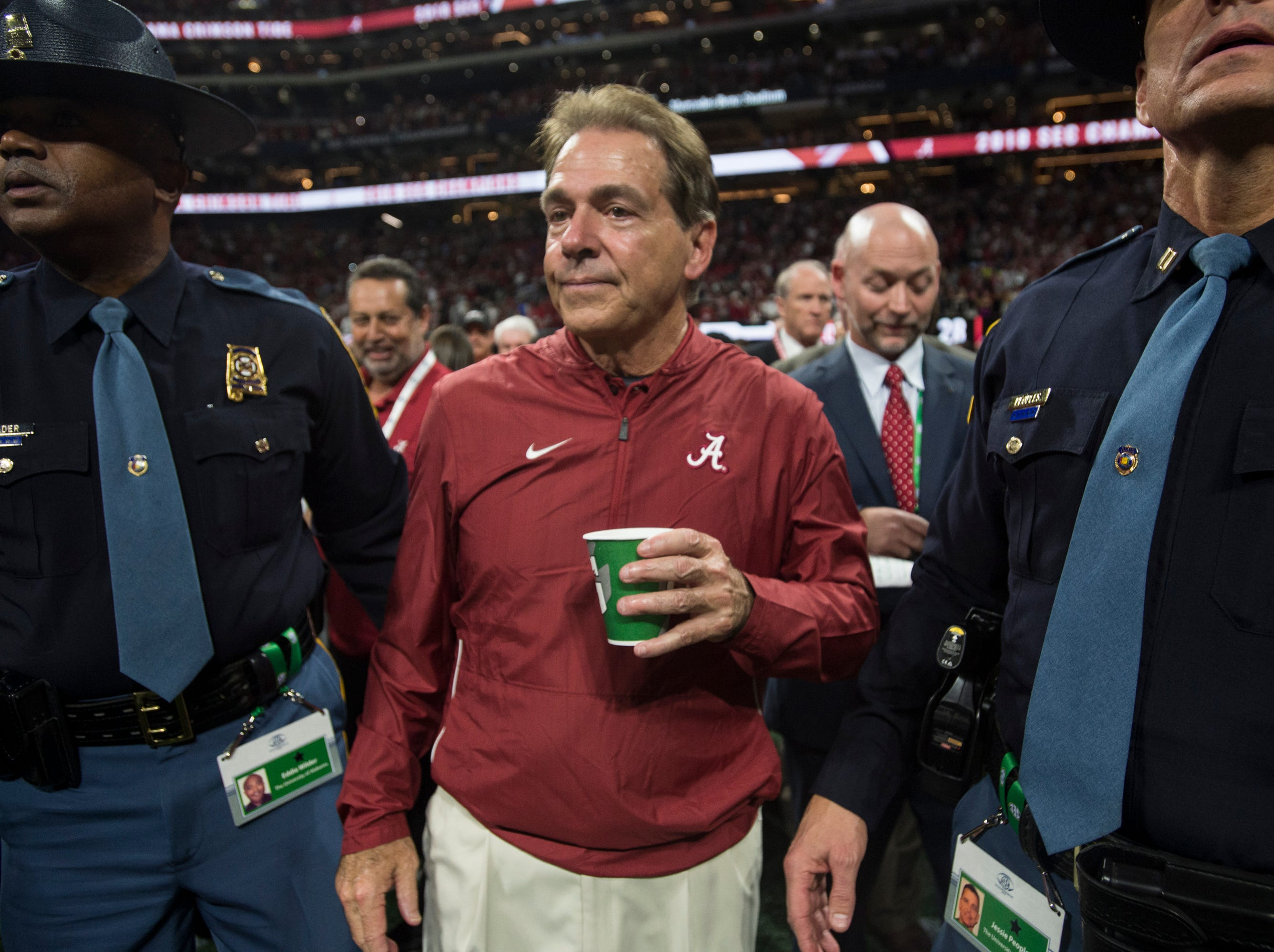 Alabama head coach Nick Saban walks the field after winning the SEC Championship game at Mercedes-Benz Stadium in Atlanta, Ga., on Saturday Dec. 1, 2018. Alabama defeated Georgia 35-28.
