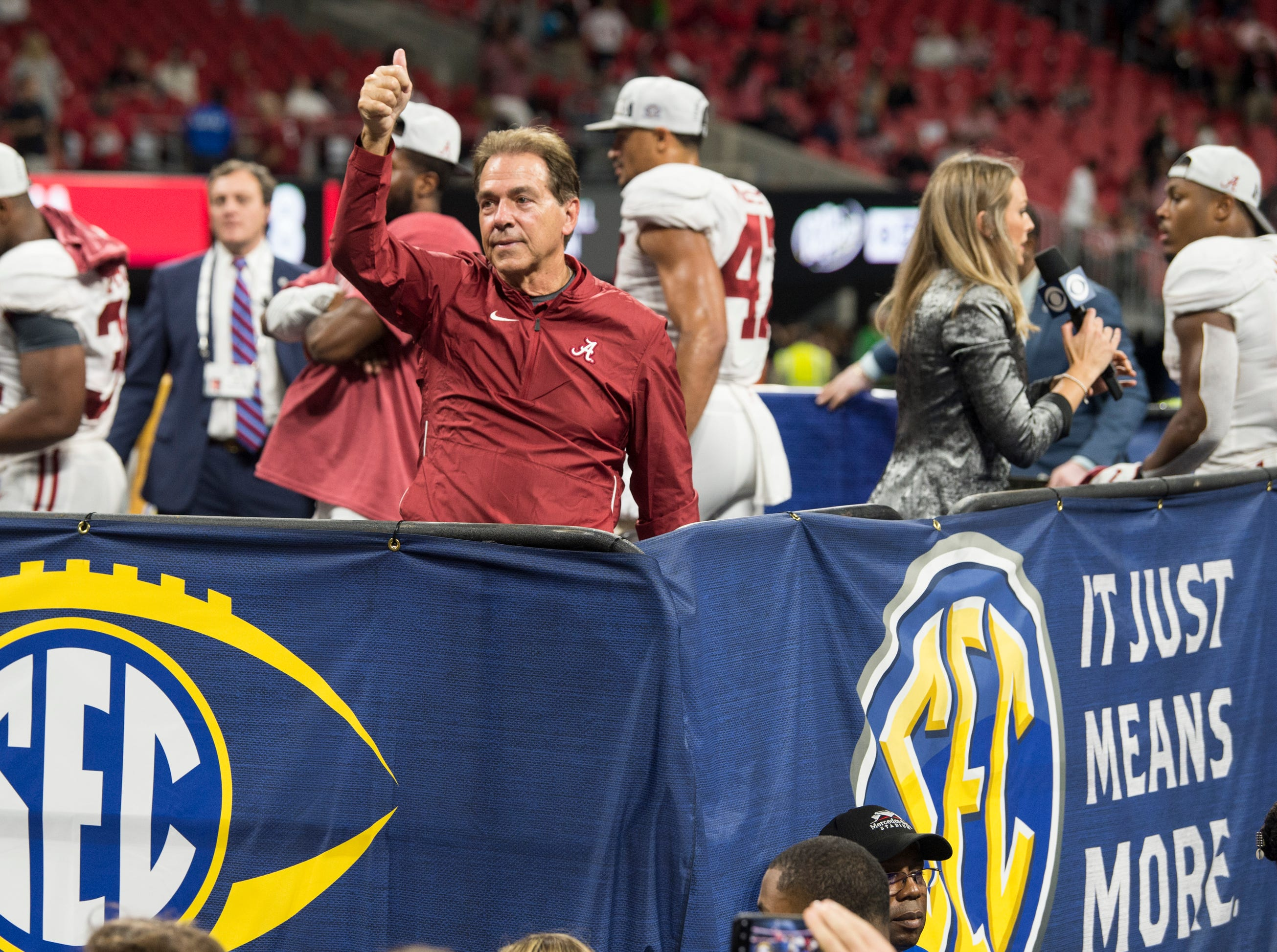 Alabama head coach Nick Saban acknowledges the crowd after winning the SEC Championship game at Mercedes-Benz Stadium in Atlanta, Ga., on Saturday Dec. 1, 2018. Alabama defeated Georgia 35-28.