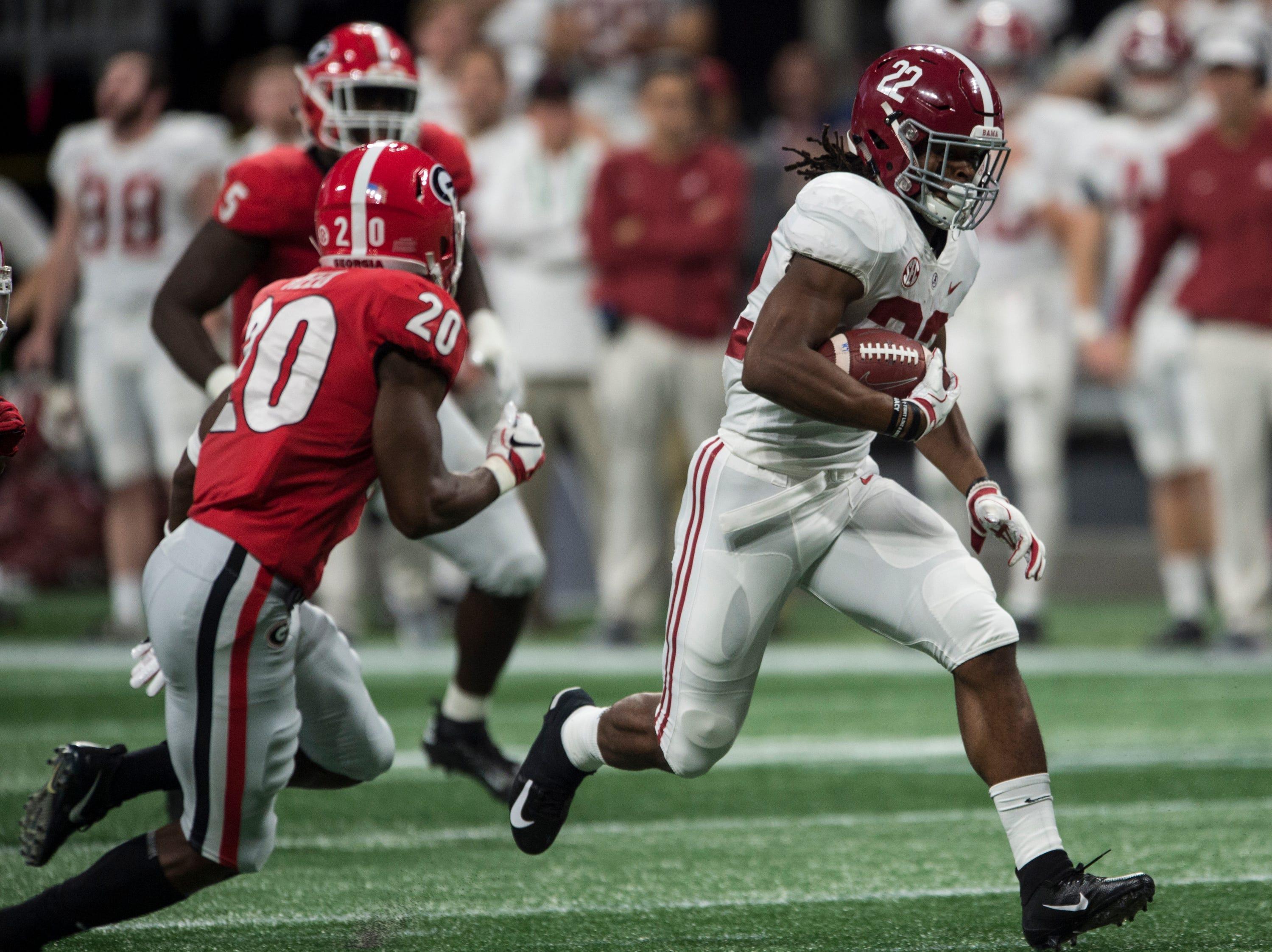 Alabama running back Najee Harris (22) runs the ball against Georgia during the SEC Championship game at Mercedes-Benz Stadium in Atlanta, Ga., on Saturday Dec. 1, 2018. Alabama defeated Georgia 35-28.