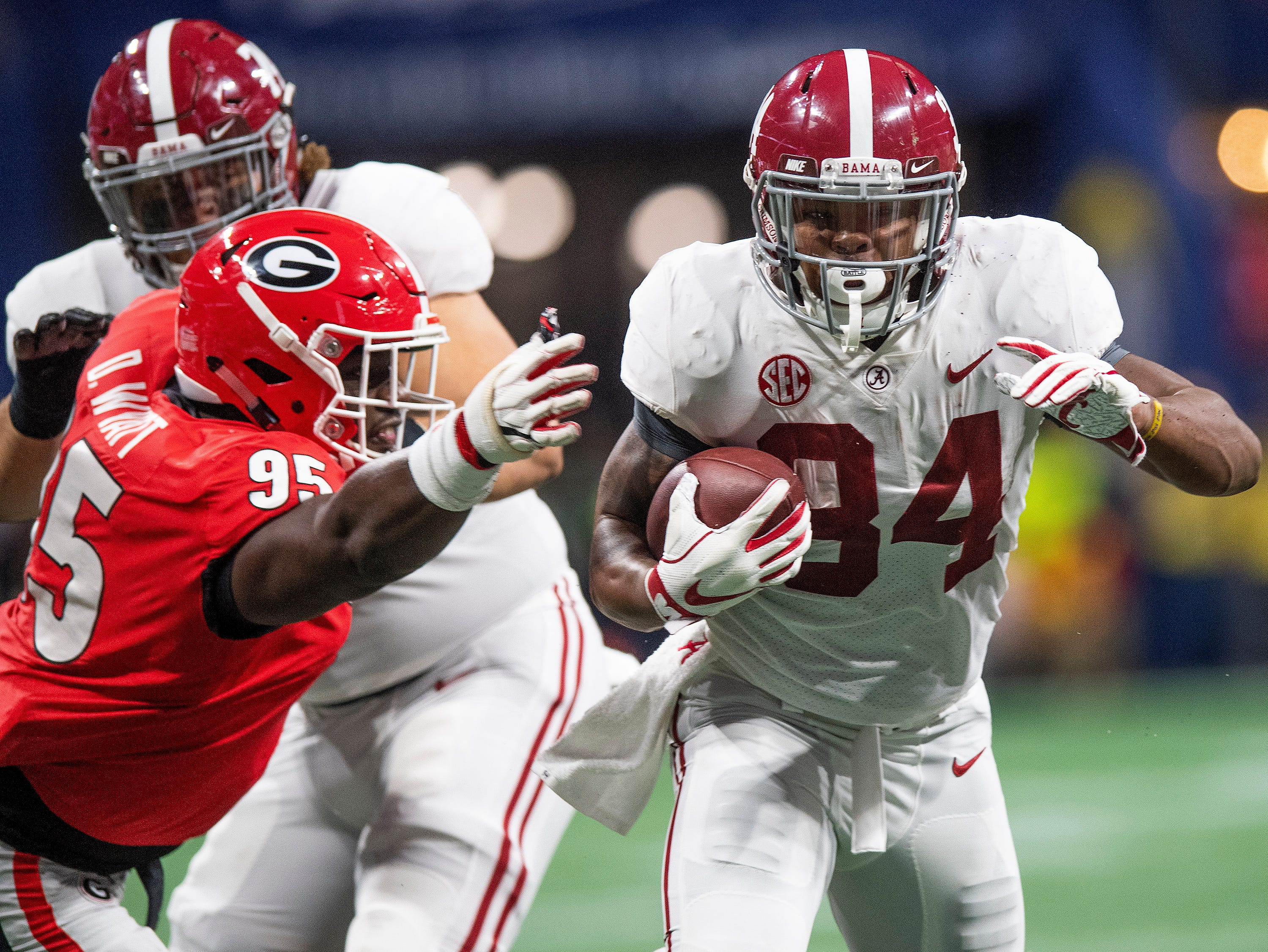 Alabama running back Damien Harris (34) carries the ball against Georgia during first half action of the SEC Championship Game at Mercedes Benz Stadium in Atlanta, Ga., on Saturday December 1, 2018.