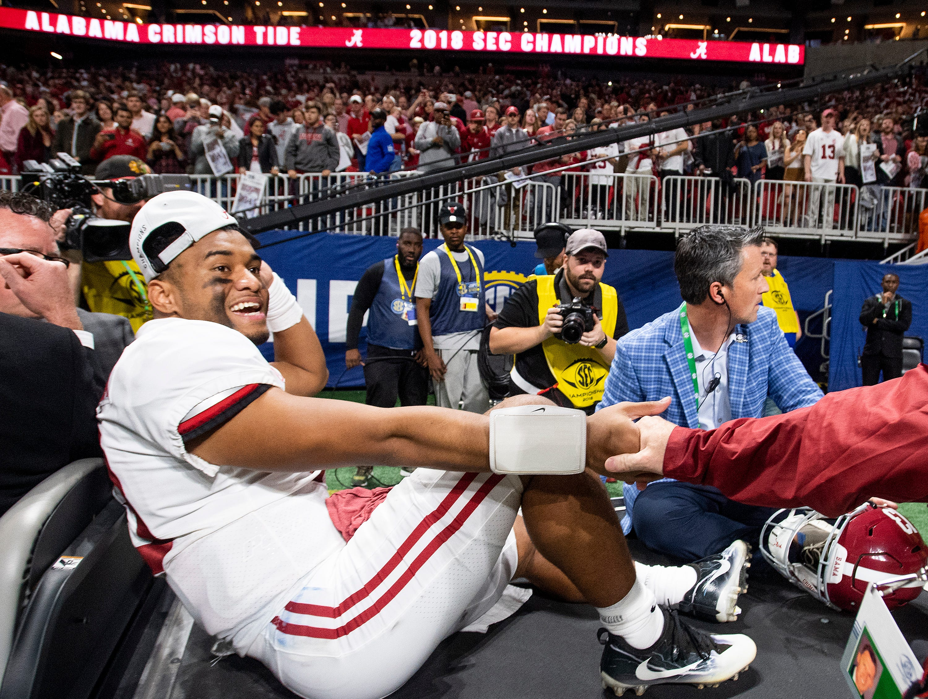 Injured Alabama quarterback Tua Tagovailoa (13) is carted off of the field after Alabama defeated Georgia in the SEC Championship Game at Mercedes Benz Stadium in Atlanta, Ga., on Saturday December 1, 2018.