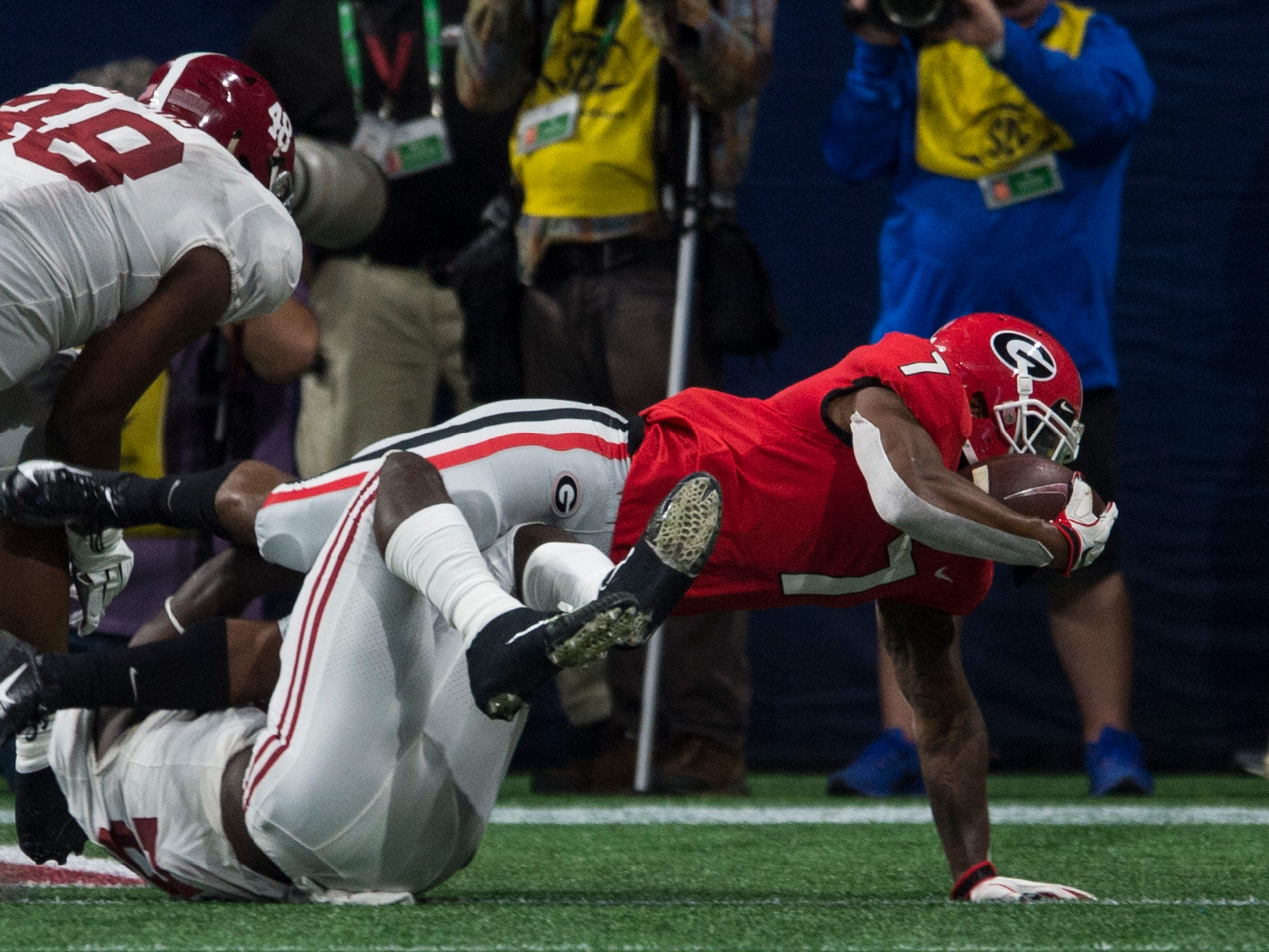 Georgia running back D'Andre Swift (7) dives into the end zone for a touchdown during the SEC Championship game at Mercedes-Benz Stadium in Atlanta, Ga., on Saturday Dec. 1, 2018. Alabama defeated Georgia 35-28.