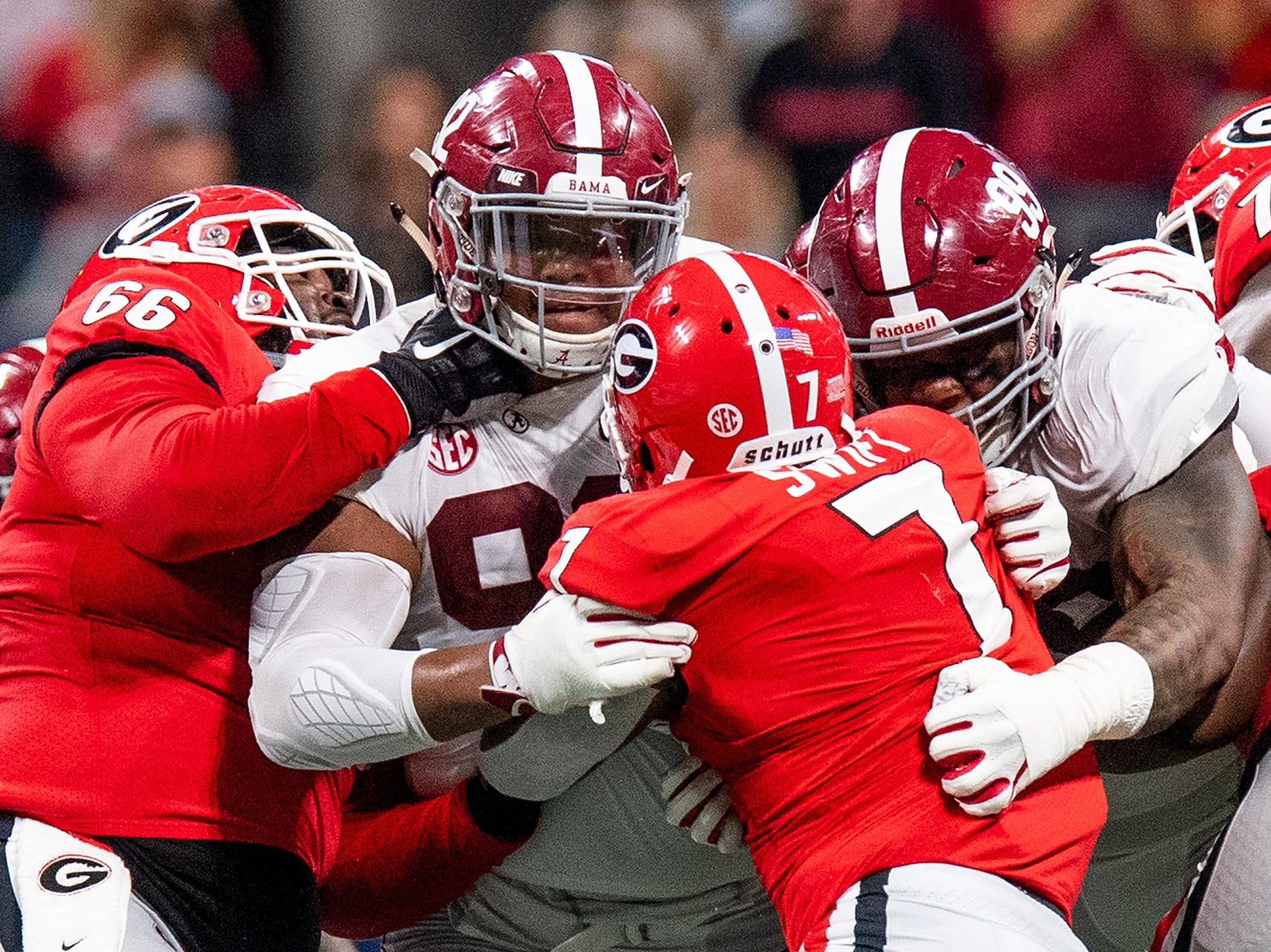 Alabama defensive linemen Quinnen Williams (92) and Raekwon Davis (99) stop Georgia running back D'Andre Swift (7) during first half action of the SEC Championship Game at Mercedes Benz Stadium in Atlanta, Ga., on Saturday December 1, 2018.
