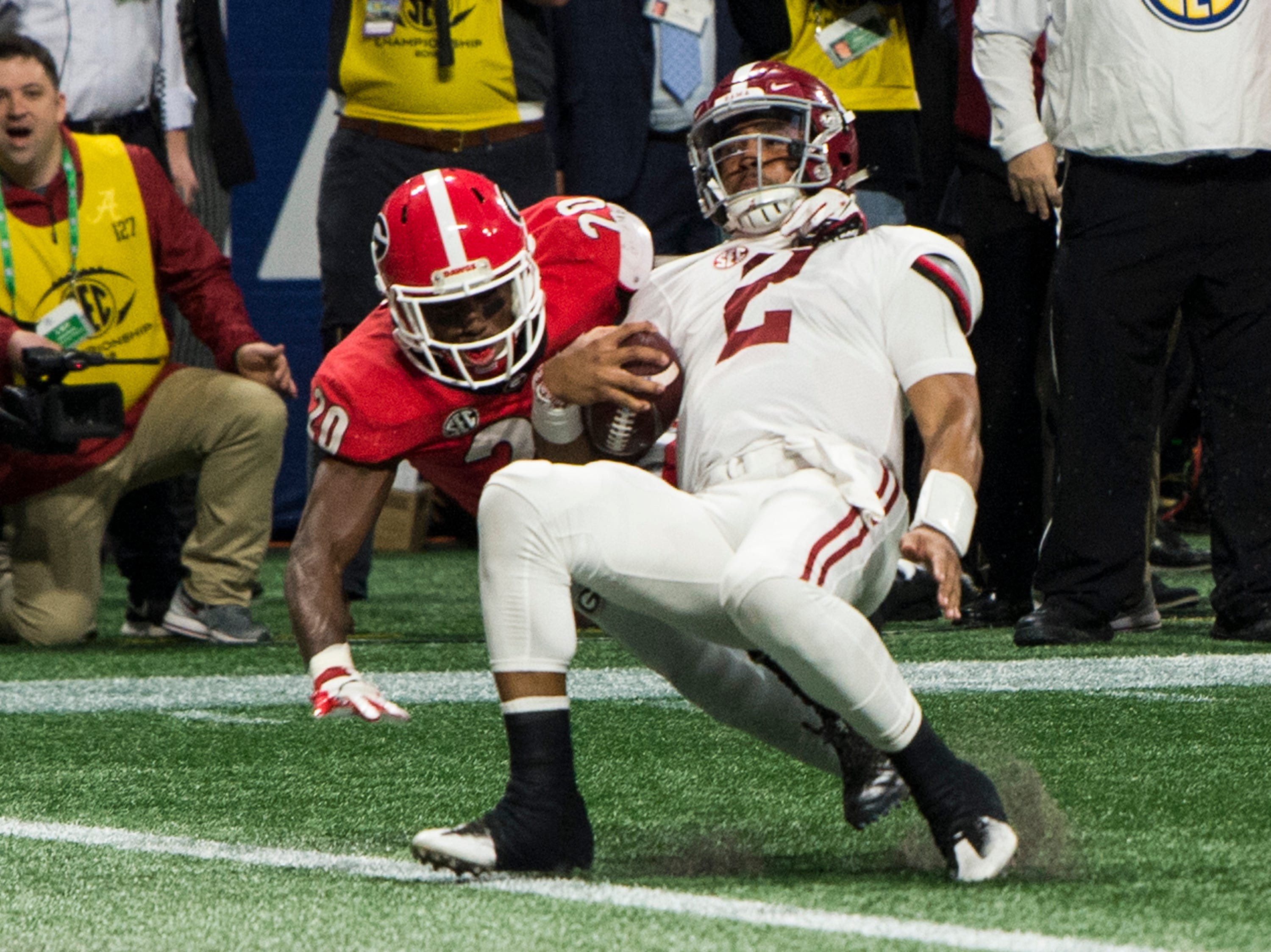 Alabama quarterback Jalen Hurts (2) pushes his way across the goal line for a touchdown during the SEC Championship game at Mercedes-Benz Stadium in Atlanta, Ga., on Saturday Dec. 1, 2018. Alabama defeated Georgia 35-28.