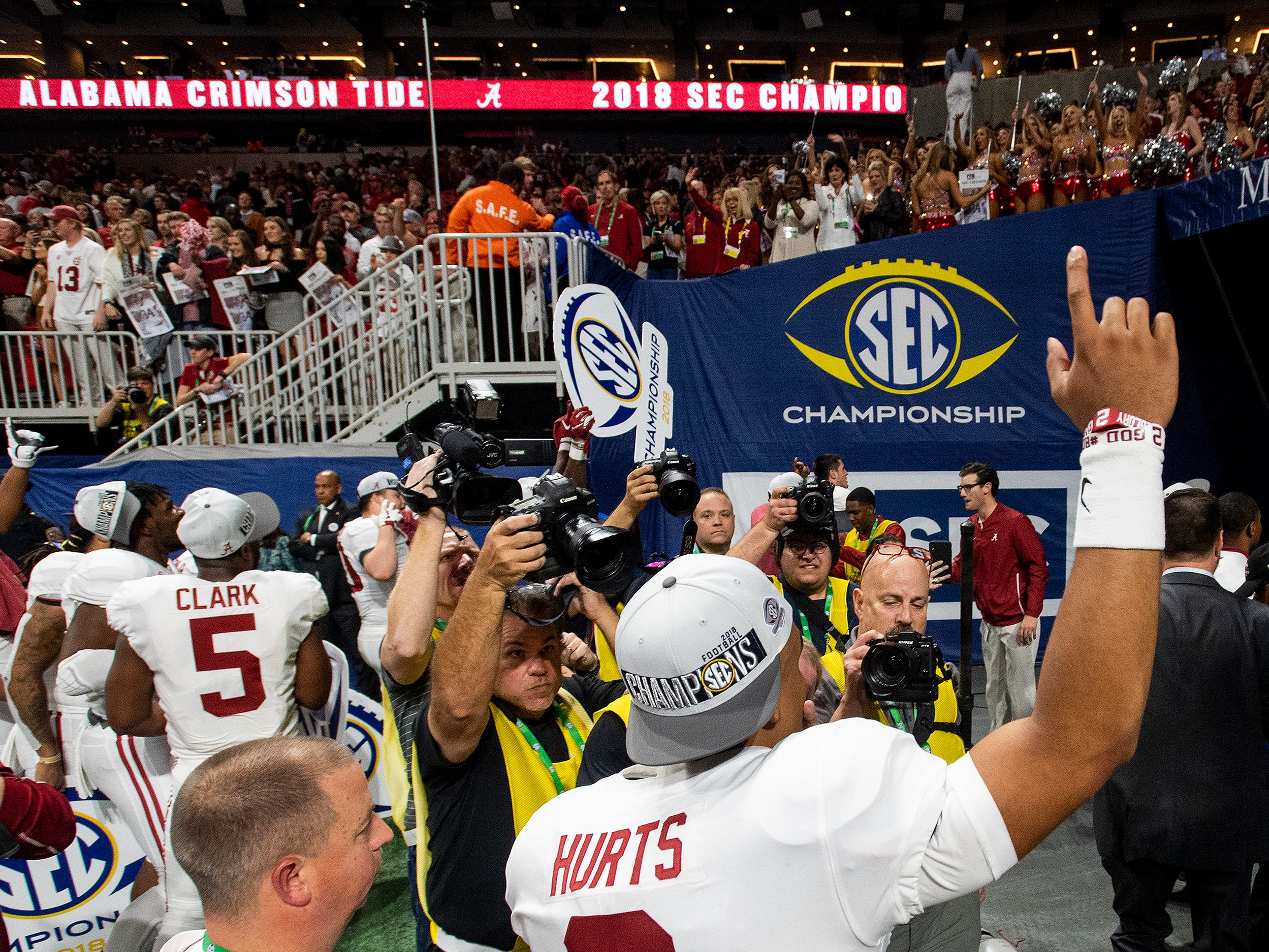 Alabama quarterback Jalen Hurts (2) leaves the field after defeating Georgia in the SEC Championship Game at Mercedes Benz Stadium in Atlanta, Ga., on Saturday December 1, 2018.