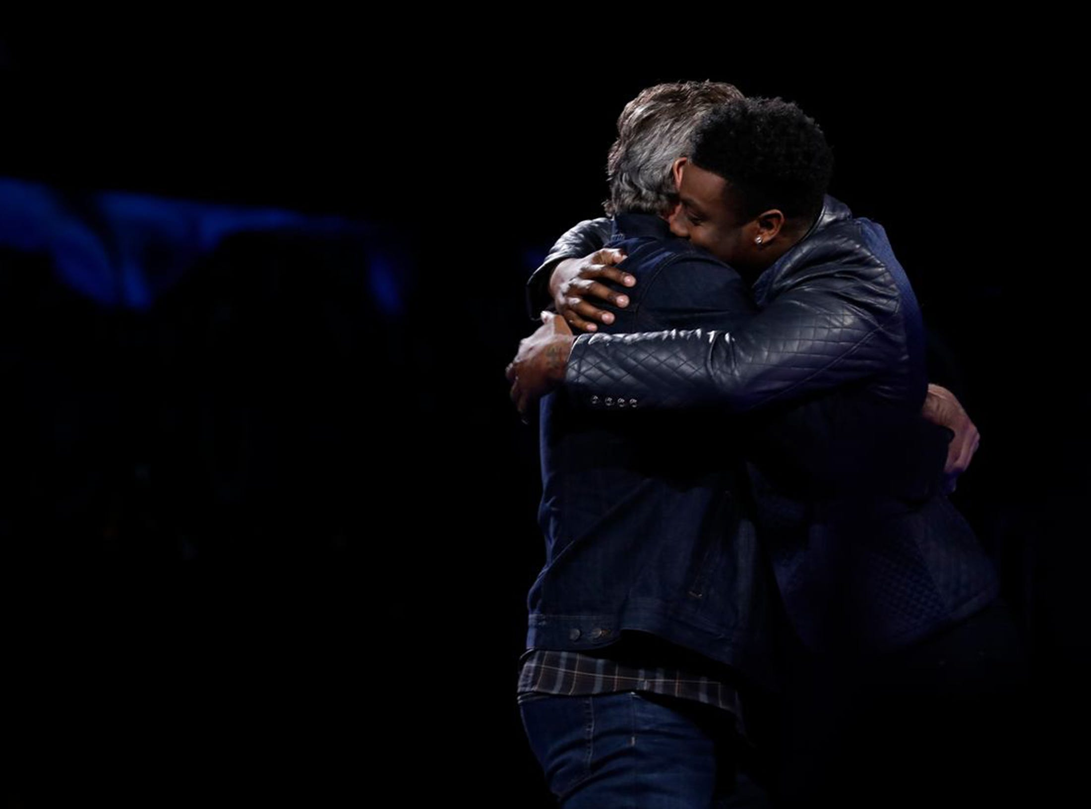 "Montgomery resident Kirk Jay, right, hugs his coach Blake Shelton after hearing he'd been saved into the top 10 on NBC's ""The Voice"" Tuesday, Nov. 27."