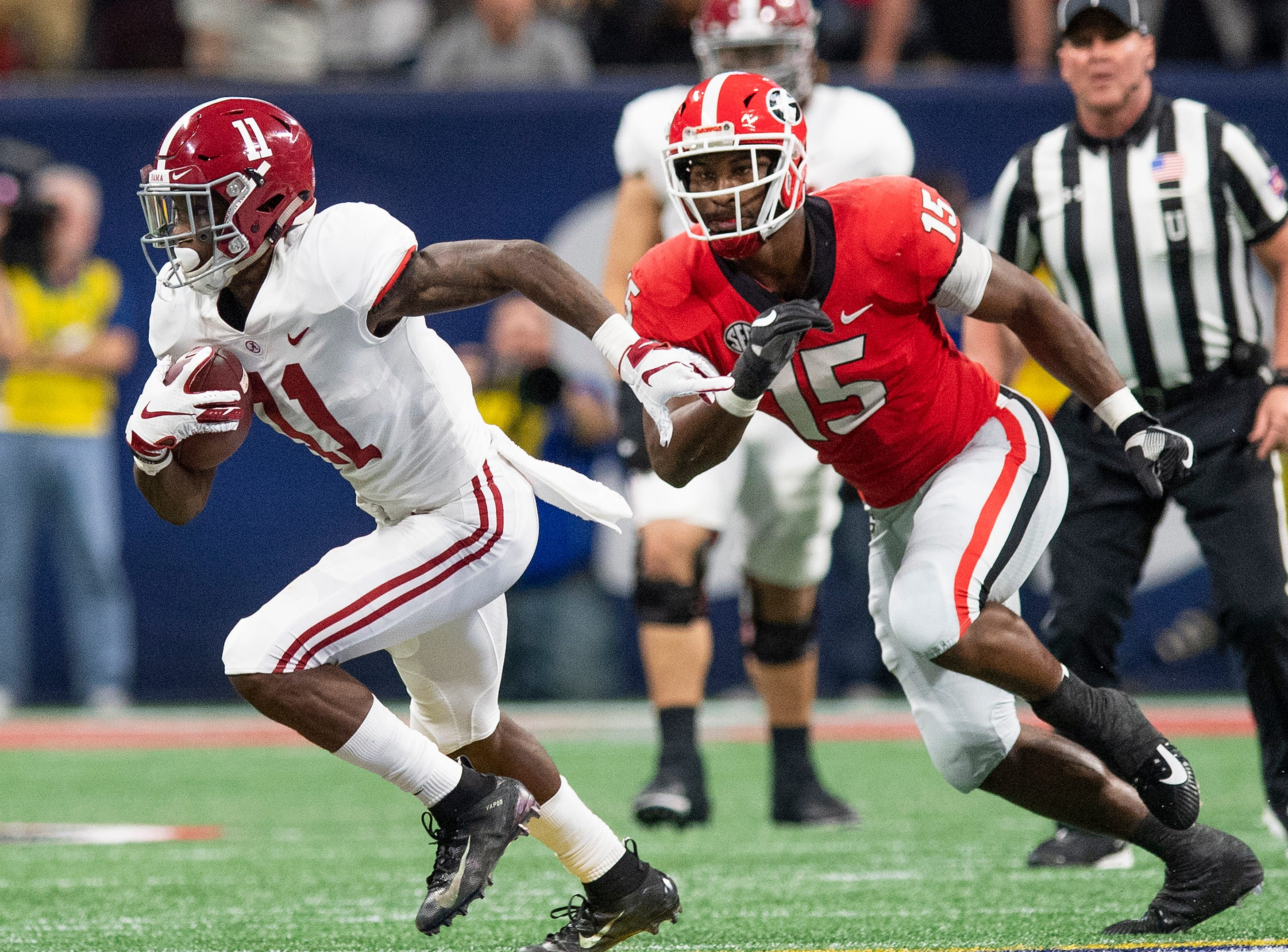 Alabama wide receiver Henry Ruggs, III, (11) carries the ball against Georgia linebacker D'Andre Walker (15) during first half action of the SEC Championship Game at Mercedes Benz Stadium in Atlanta, Ga., on Saturday December 1, 2018.