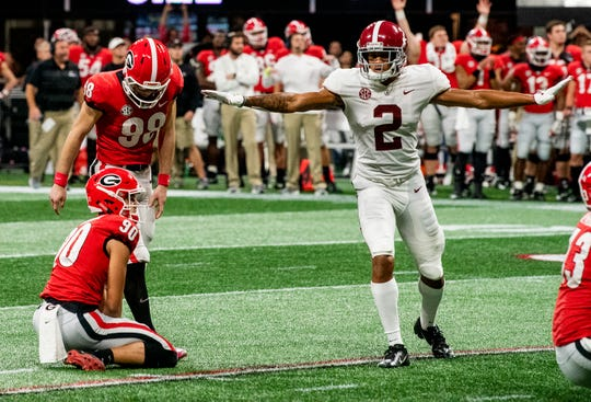 Georgia kicker Rodrigo Blankenship (98) misses a field goal late as Alabama defensive back Patrick Surtain, II, (2) celebrates in the SEC Championship Game at Mercedes Benz Stadium in Atlanta, Ga., on Saturday December 1, 2018.