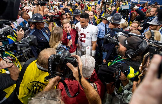 Alabama head coach Nick Saban and quarterback Jalen Hurts (2) are surrounded by media after defeating Georgia in the SEC Championship Game at Mercedes Benz Stadium in Atlanta, Ga., on Saturday December 1, 2018.