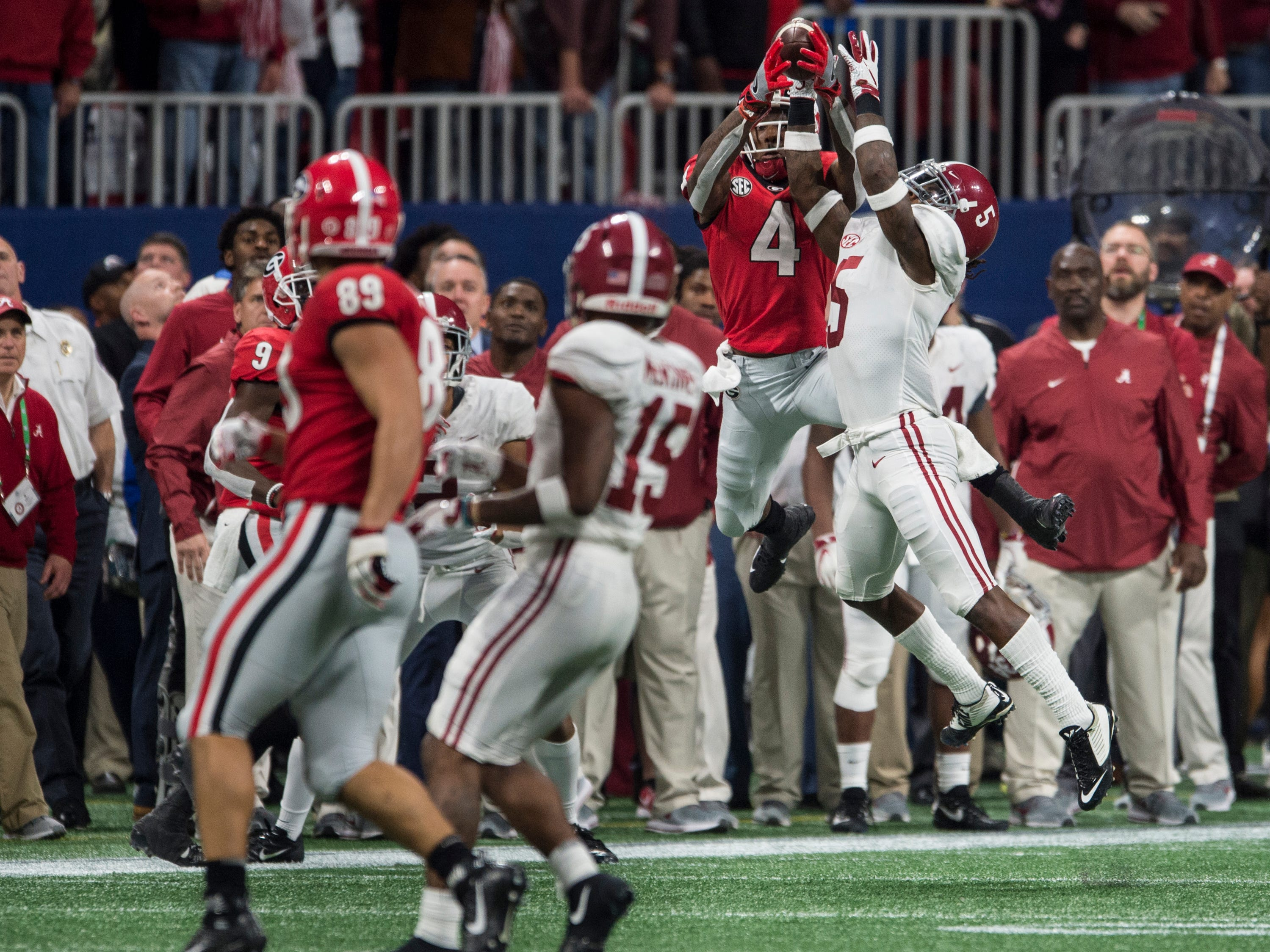 Alabama defensive back Shyheim Carter (5) breaks up a pass intended for Georgia wide receiver Mecole Hardman (4) during the SEC Championship game at Mercedes-Benz Stadium in Atlanta, Ga., on Saturday Dec. 1, 2018. Alabama defeated Georgia 35-28.