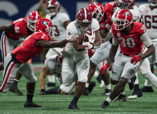 Alabama running back Josh Jacobs (8) breaks through the defense for a big gain during the SEC Championship game at Mercedes-Benz Stadium in Atlanta, Ga., on Saturday Dec. 1, 2018. Alabama defeated Georgia 35-28.