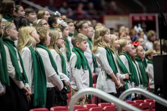Children perform musical numbers during the 82nd annual Muncie Community Christmas Sing in Worthen Arena at Ball State University in 2018. For 2019, the event returns to the Muncie Fieldhouse.