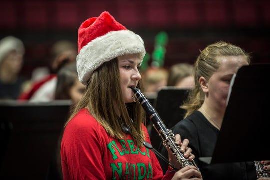 Children with the Muncie Community School District perform different musical numbers for the 82nd annual Muncie Christmas Sing last year inside Worthen Arena.