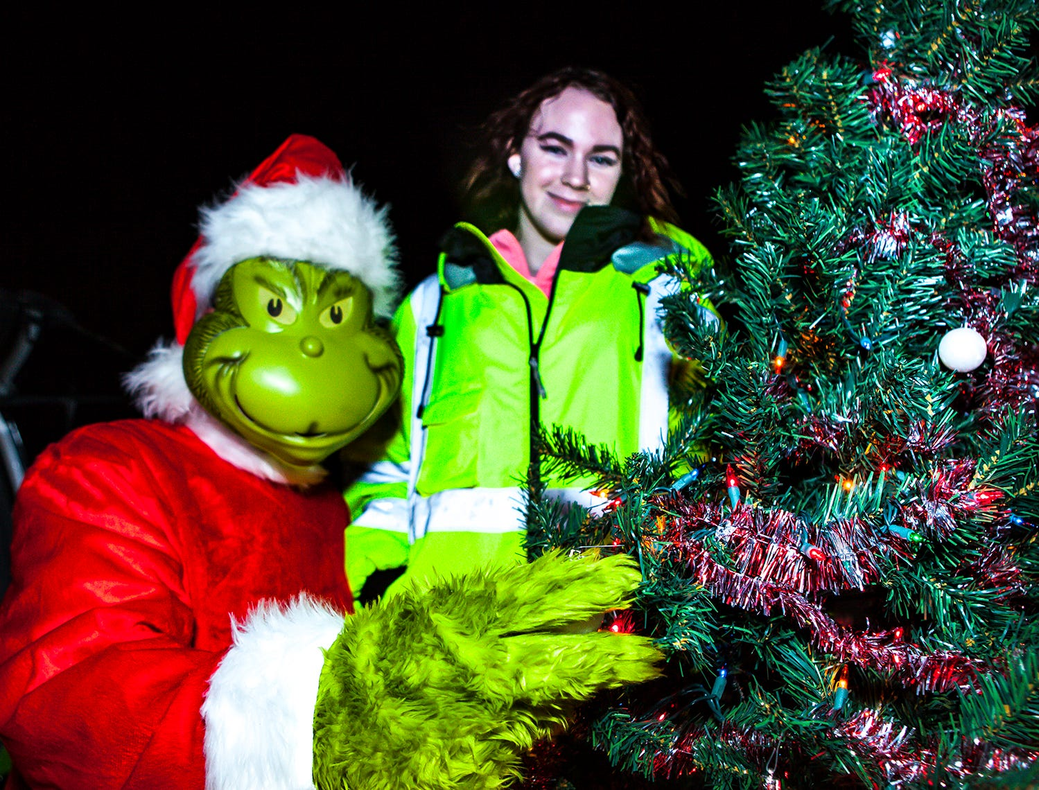 The Grinch (aka Chris Buck, a Box 100 volunteer) and daughter Ashlyn Buck at La Vergne's 2018 Christmas Parade of Lights, held Saturday, Dec. 1, 2018.