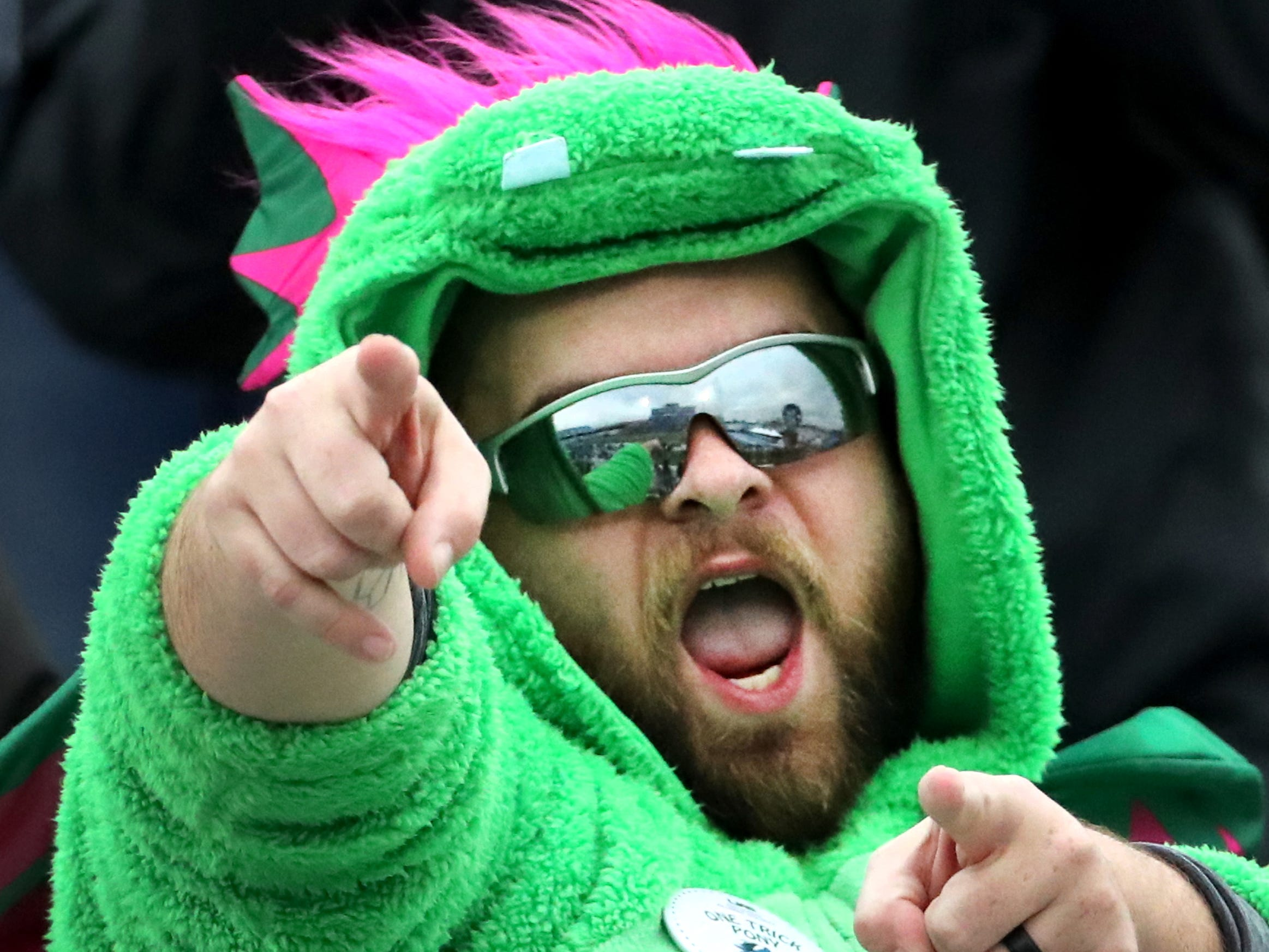 UAB fan Daniel Walter cheers on his team while dressed in a dragon costume during the Conference USA Championship game against MTSU at MTSU on Saturday, Dec. 1, 2018.