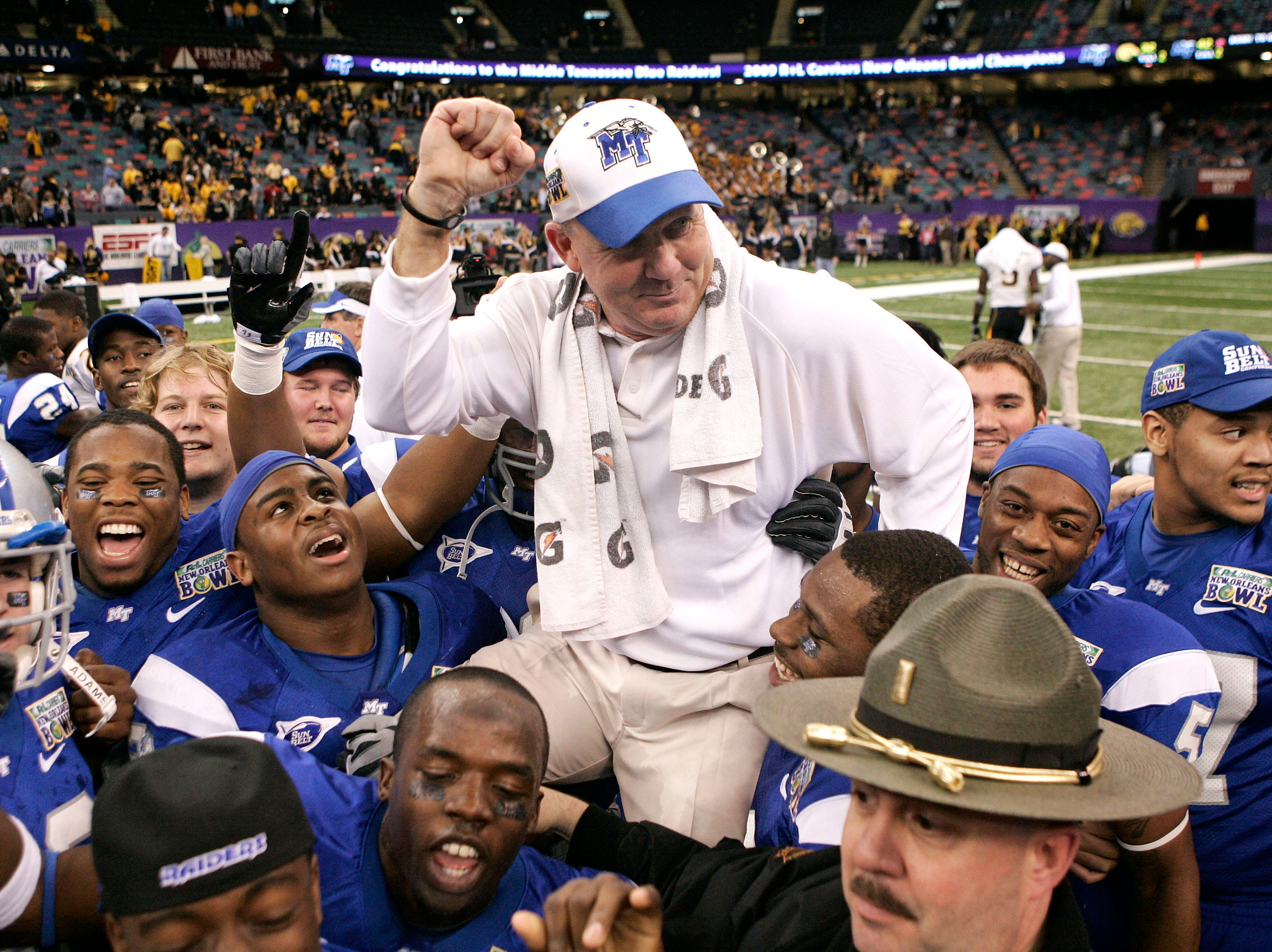 Middle Tennessee head coach Rick Stockstill celebrates with his players after the team defeated Southern Mississippi 42-32 in the New Orleans Bowl NCAA college football game in New Orleans, Sunday, Dec. 20, 2009. (AP Photo/Patrick Semansky)