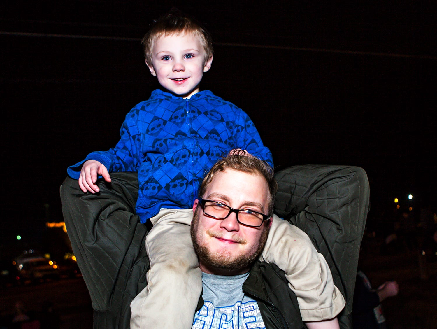 Chris Richesin, 4, gets a good view of the action thanks to his father Doug  at La Vergne's 2018 Christmas Parade of Lights, held Saturday, Dec. 1, 2018.