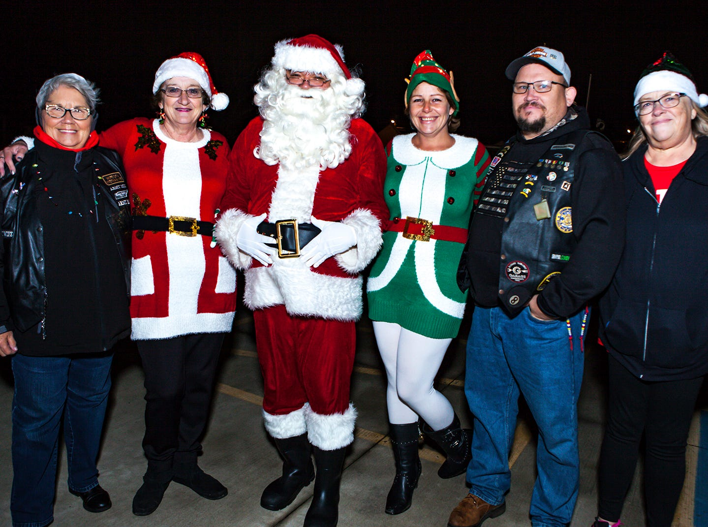 Elaine Oakley, Denise Frazier,  Santa, Felisha Conaway, Chris Oakley and Debbie Gentry at La Vergne's 2018 Christmas Parade of Lights, held Saturday, Dec. 1, 2018.