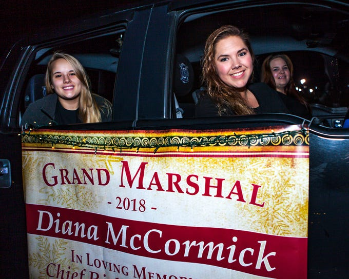 Ashley McCormick, left, and Diana McCormick, ,right, prepare to ride in La Vergne's 2018 Christmas Parade of Lights, held Saturday, Dec. 1, 2018. Diana McCormick was grand marshal of the parade, in memory of her husband, Fire Chief Rick McCormick.