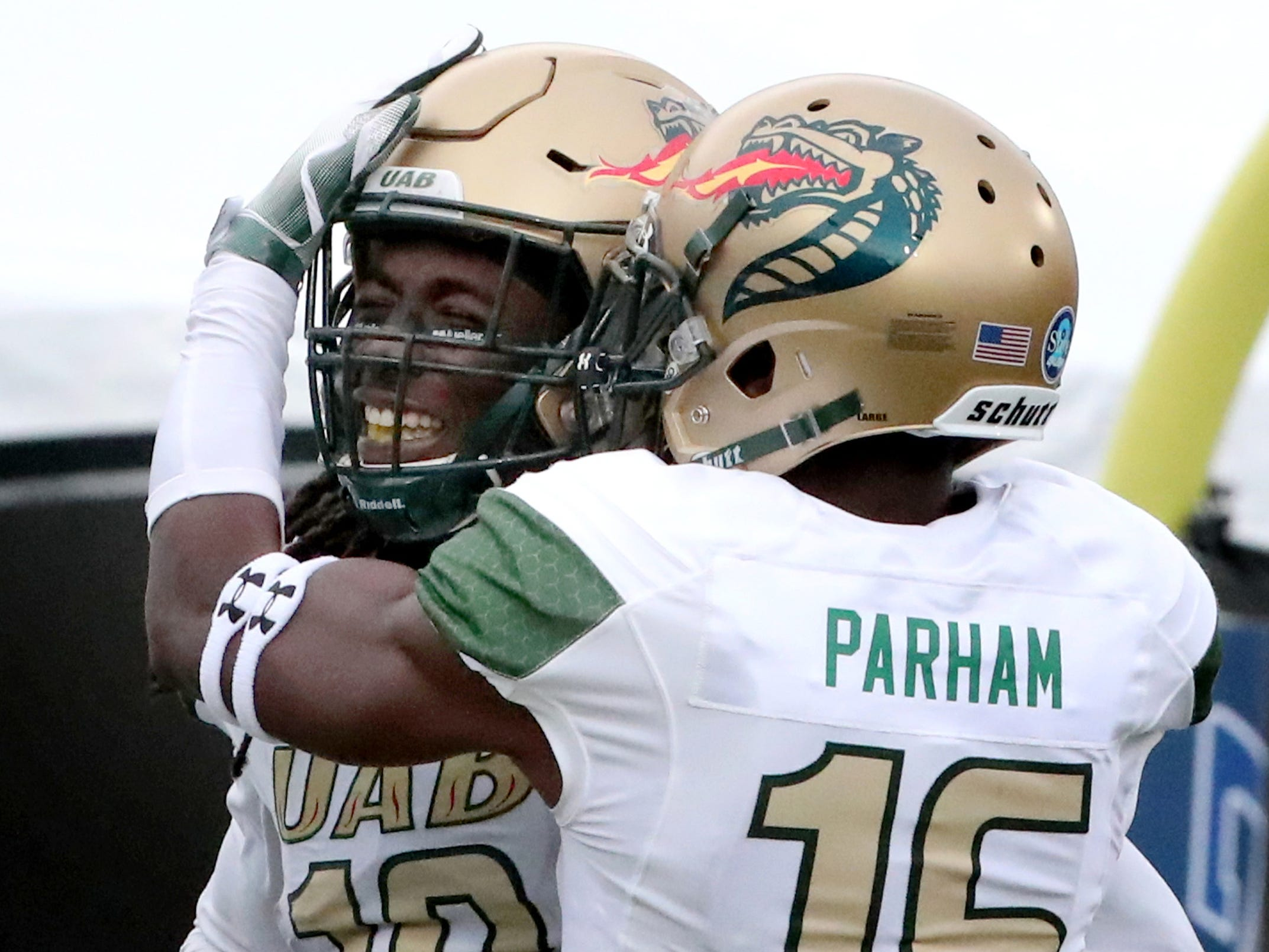 UAB's wide receiver Kendall Parham (16) celebrates UAB's wide receiver Kailon Carter 's (18) catch against MTSU during the Conference USA Championship at MTSU on Saturday, Dec. 1, 2018.