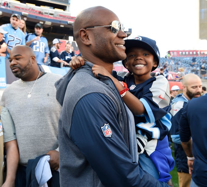 Keith Bulluck and son Cody with Albert Haynesworth behind them chat during alumni weekend activities pregame at Nissan Stadium Sunday, Dec. 2, 2018, in Nashville, Tenn.