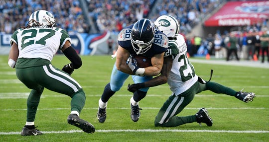 Titans tight end Anthony Firkser (86) heads in for his first NFL touchdown against the Jets last season.
