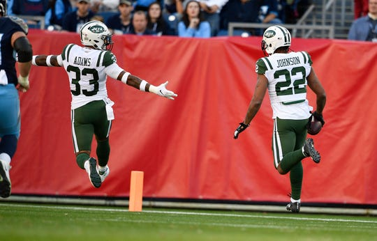 Jets cornerback Trumaine Johnson (22) runs an interception in for a touchdown escorted by safety Jamal Adams (33) in the first quarter at Nissan Stadium Sunday, Dec. 2, 2018, in Nashville, Tenn.