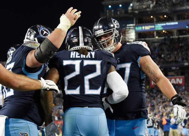 Titans running back Derrick Henry (22) celebrates his touchdown in the third quarter Sunday.