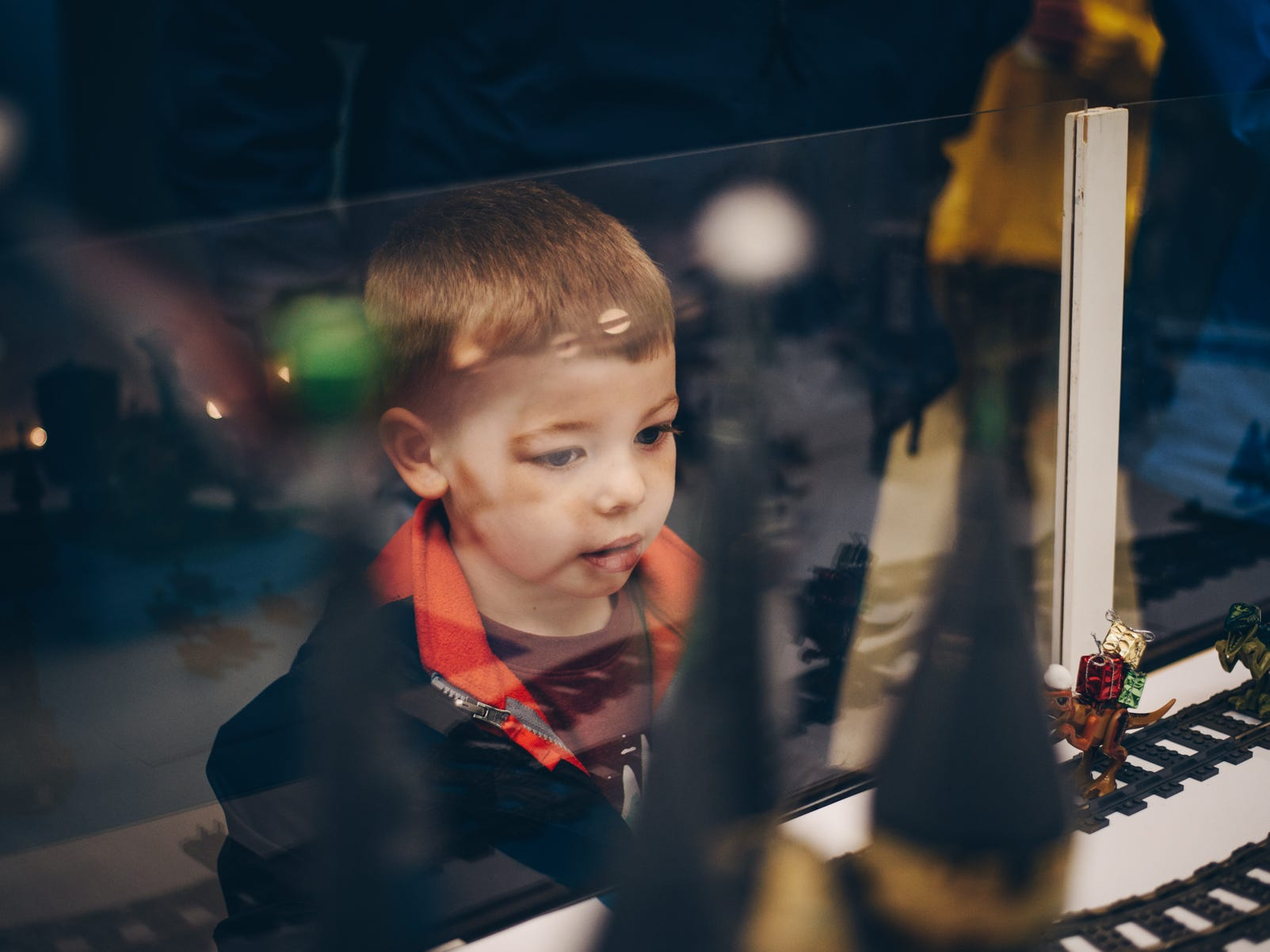 Max Irby, 4, checks out the Harry Potter train setup in the Granville Public Library during Saturday's Christmas Candlelight Walking Tour.