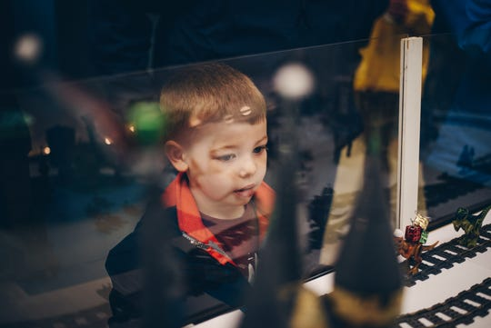 Max Irby, 4, checks out the Harry Potter train setup in the Granville Public Library during the 2018 Christmas Candlelight Walking Tour.